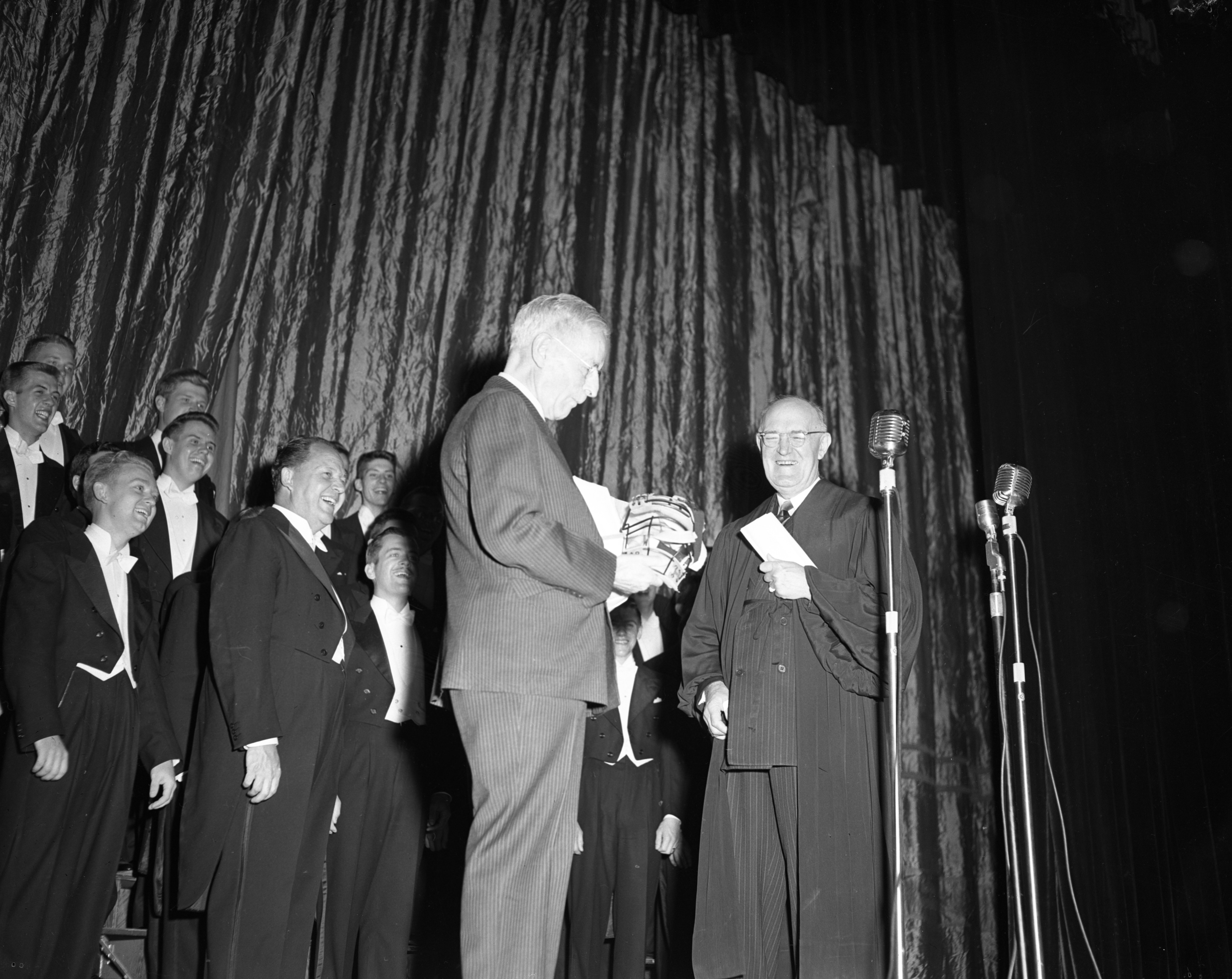 "Author Shirley W. Smith receives an 'Oscar' of a different sort from local attorney George J. Burke at the ""author's premiere"" at the Michigan Theater, May 1949 image"