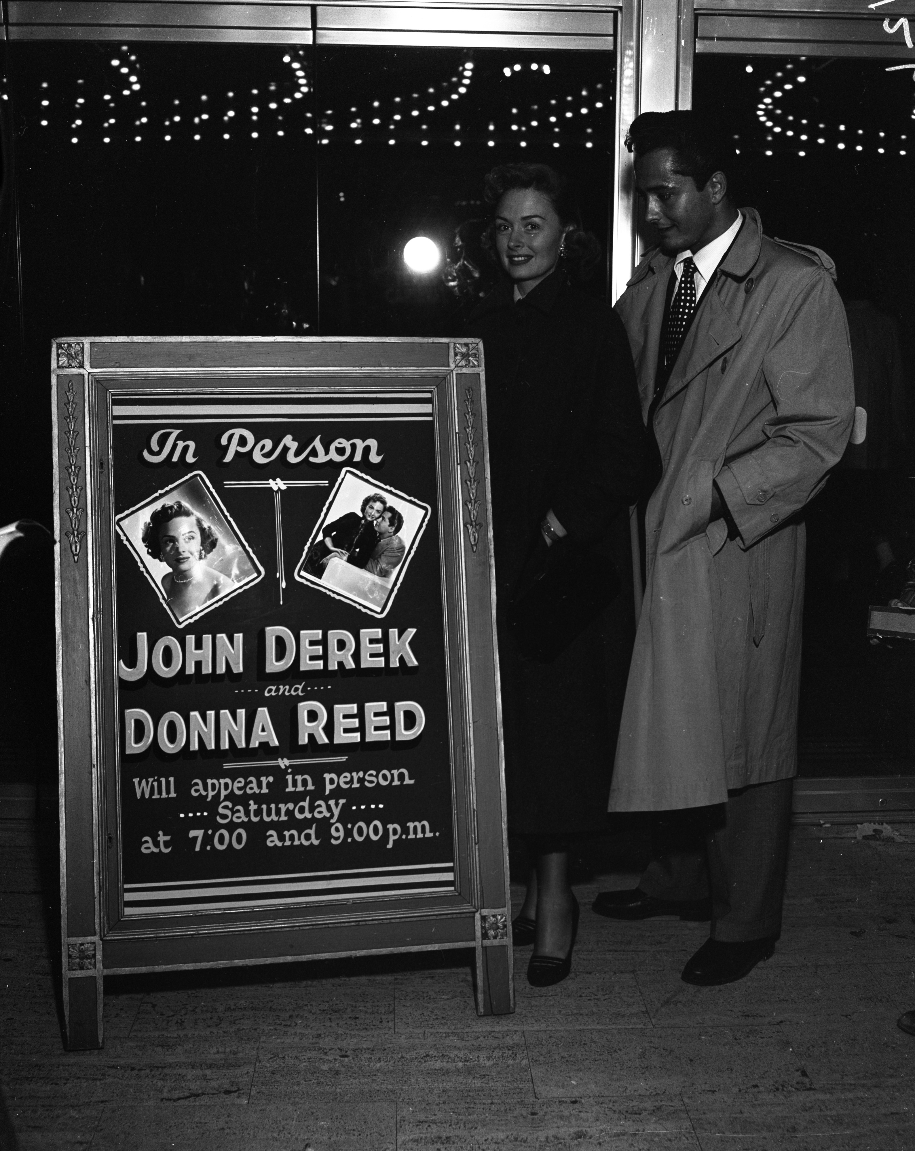 "Actors John Derek and Donna Reed appear at the Michigan Theater for the screening of ""Saturday's Hero,"" September 29, 1951 image"