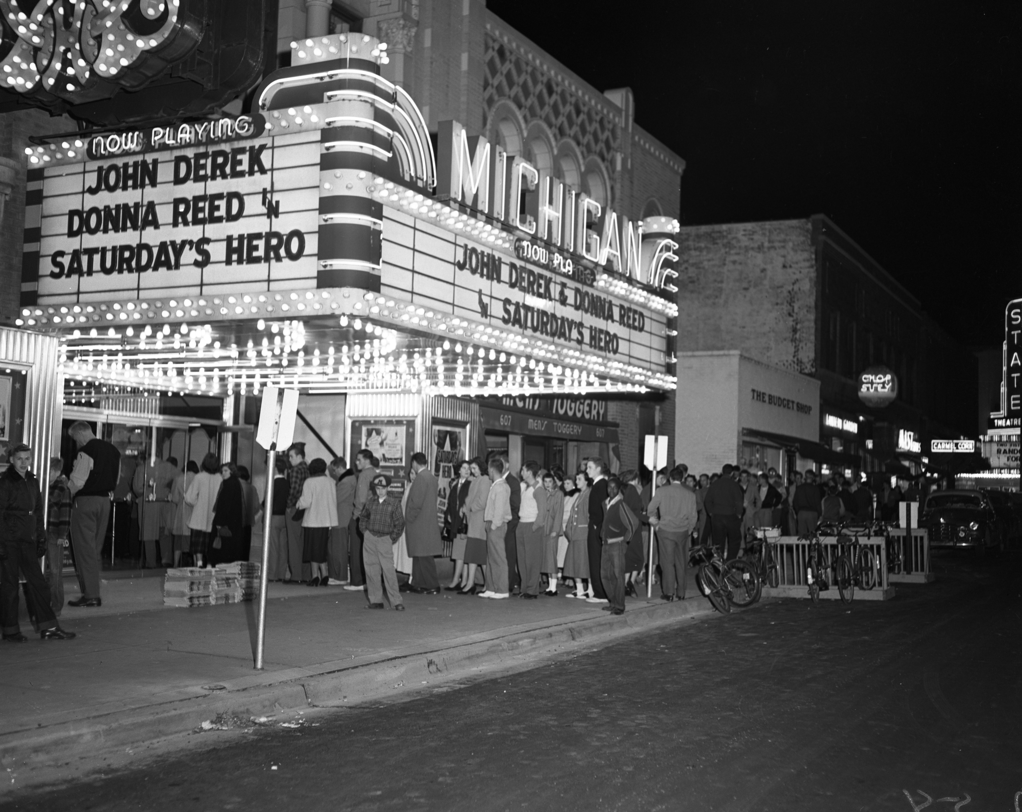"Crowd at the Michigan Theater waiting to see actors Donna Reed and John Derek at the screening of ""Saturday's Hero,"" September 29, 1951 image"