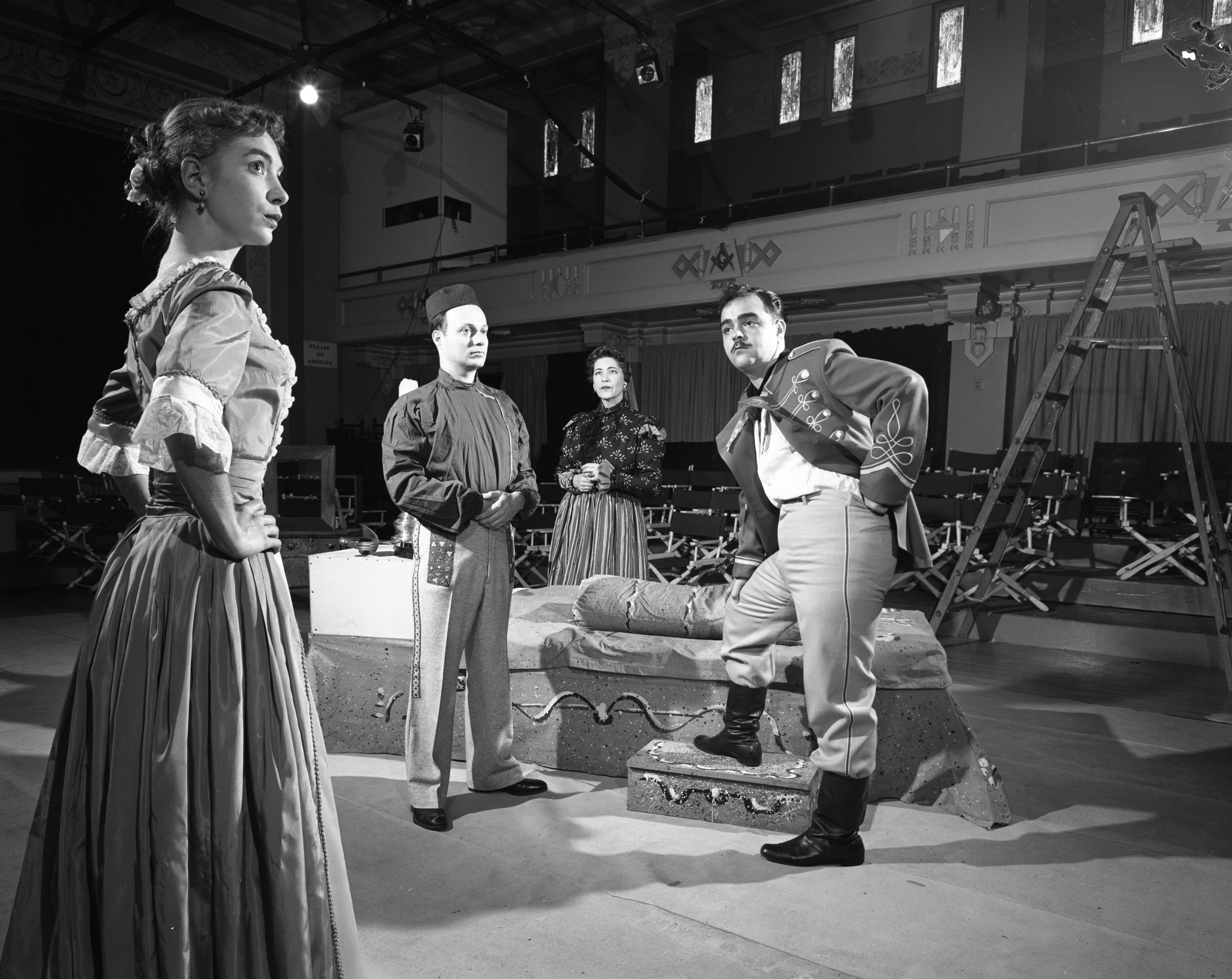 "Irma Lee Hurley, Wilfred Kaplan, Barbara Lawrence and James Coco rehearse ""Arms and the Man"" at the Masonic Temple, October 1954 image"