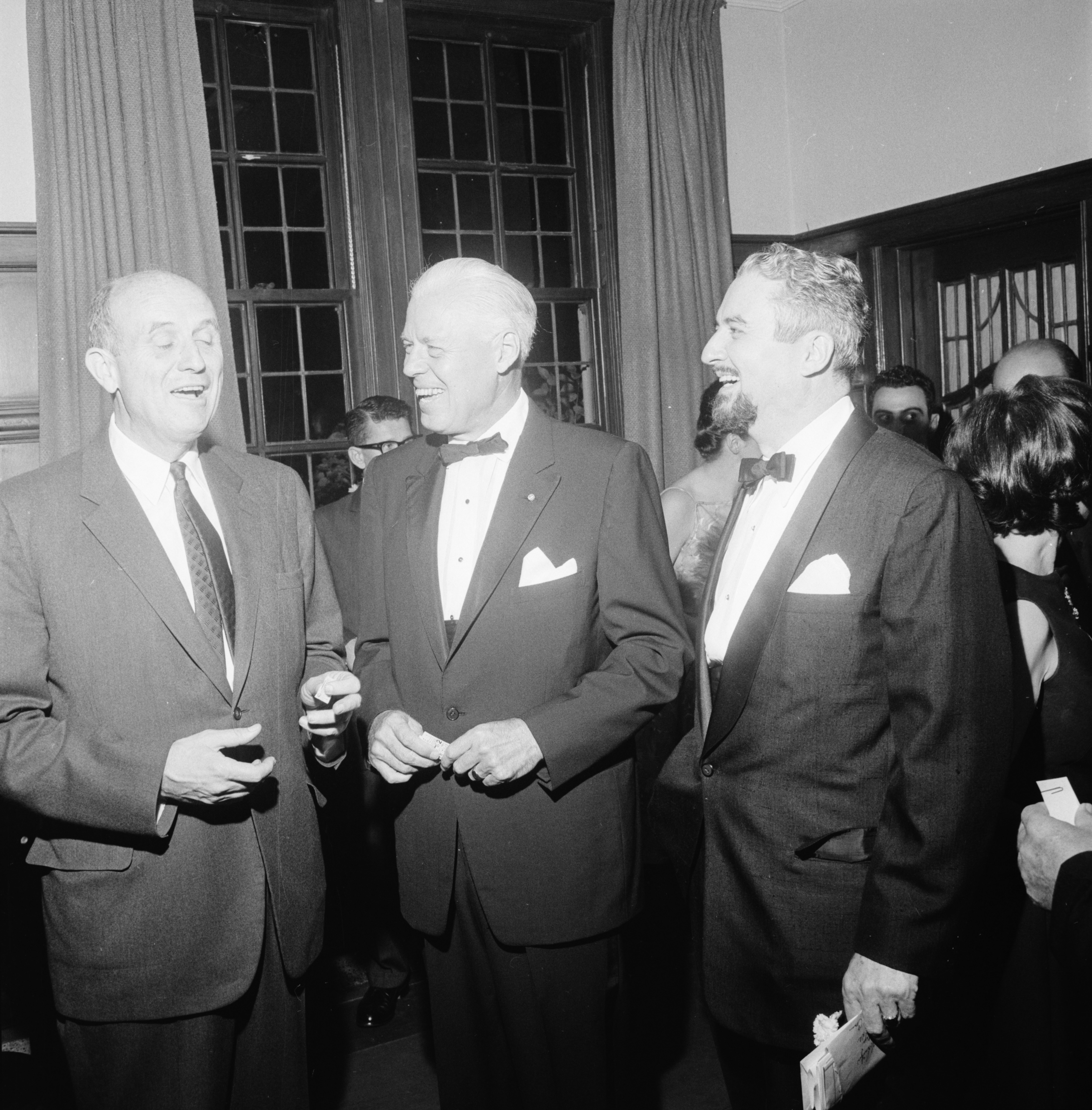 U-M President Harlan Hatcher and Professor Robert C. Schnitzer, head of the University's Professional Theater Program on opening night, October 1962 image