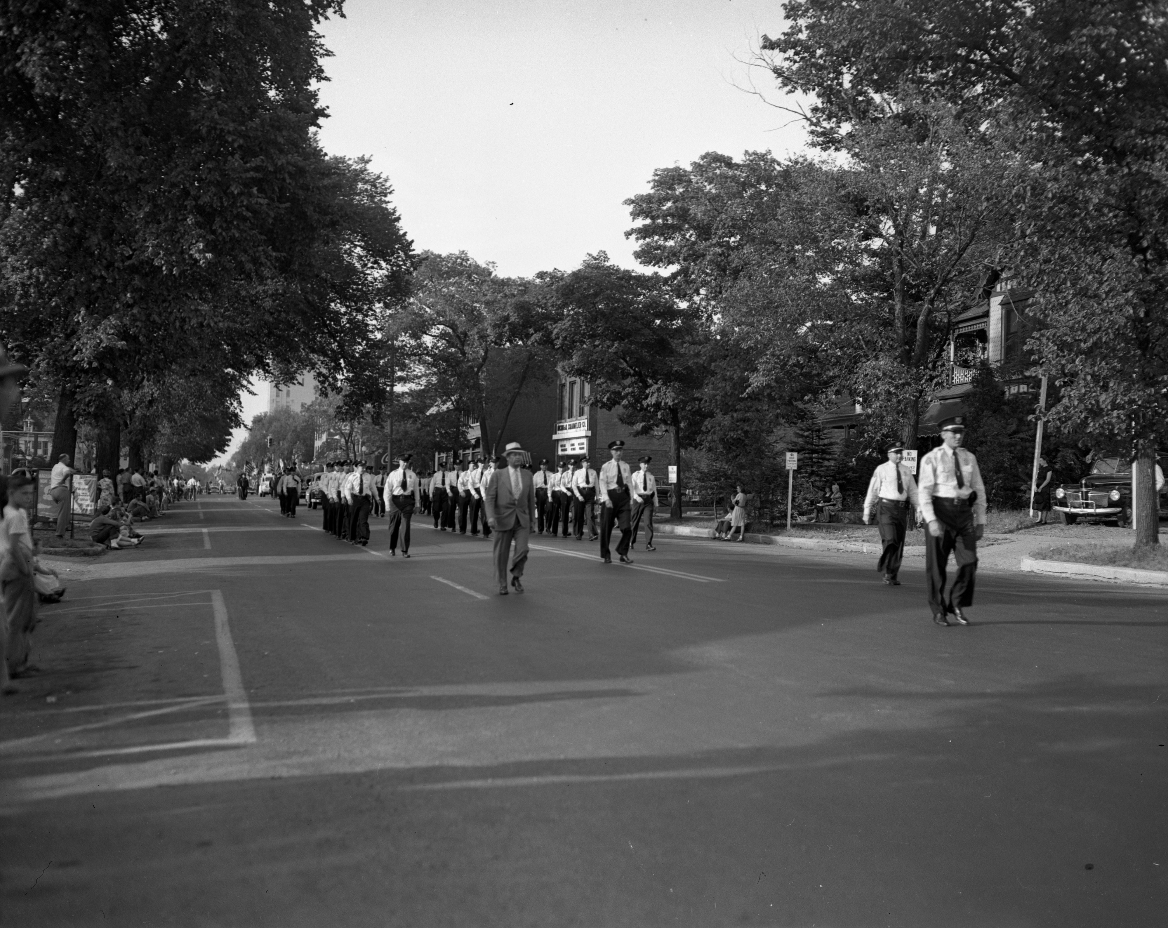 Ann Arbor Police Department Steps Sharply In the All-Veterans Freedom Train Parade, August 1948 image