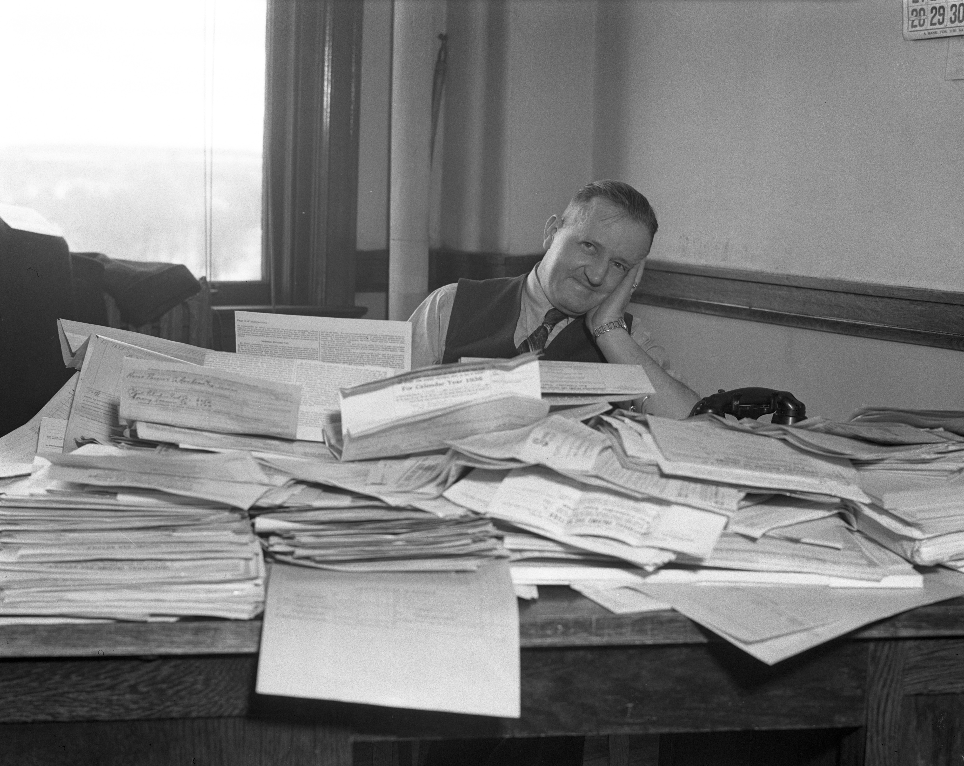 Frank W. Stampfler, Internal Revenue Collector, Swamped With Tax Returns, March 16, 1937 image