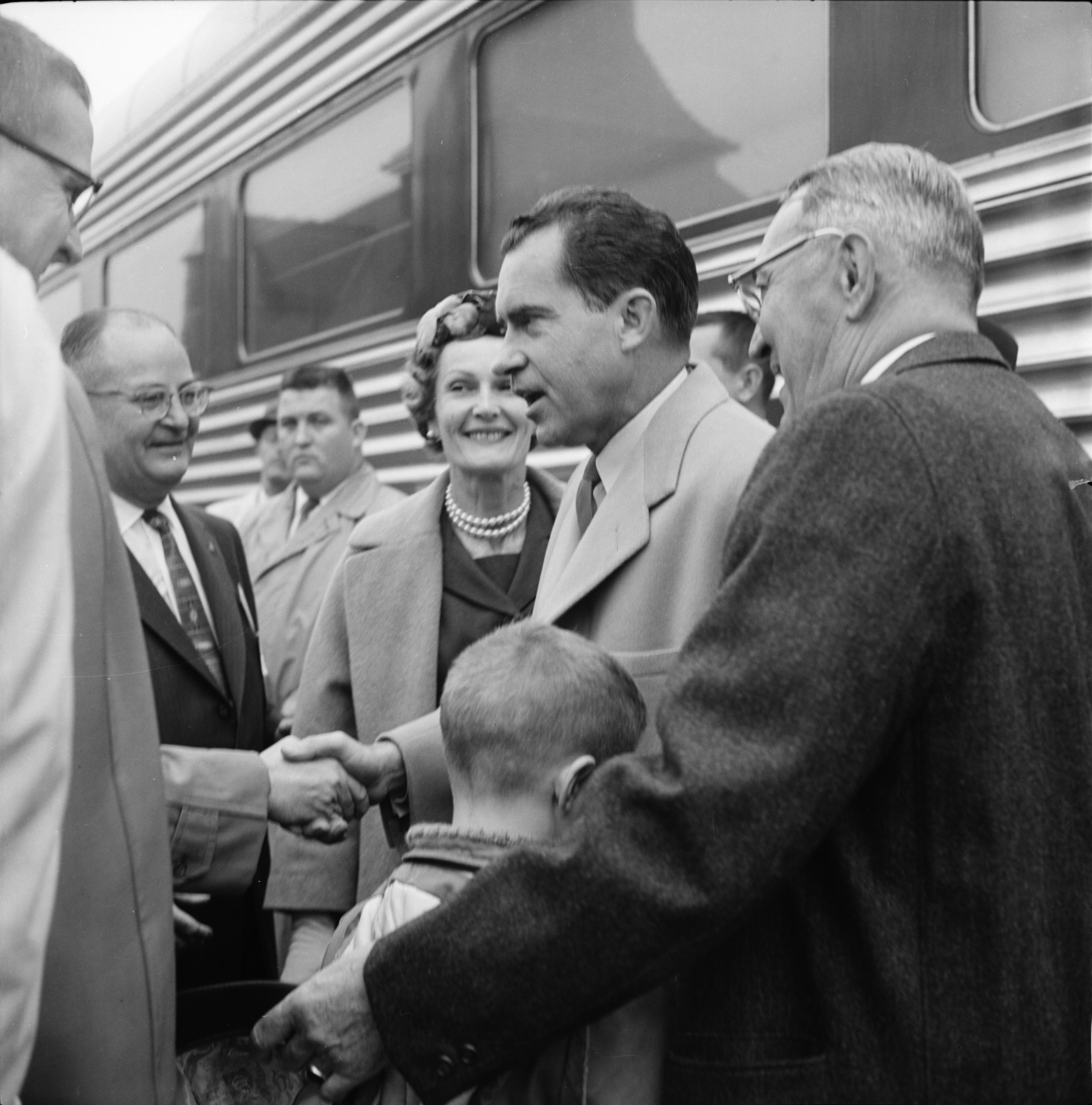 Presidential candidate Richard Nixon shakes hands during Ann Arbor visit, October 27, 1960 image