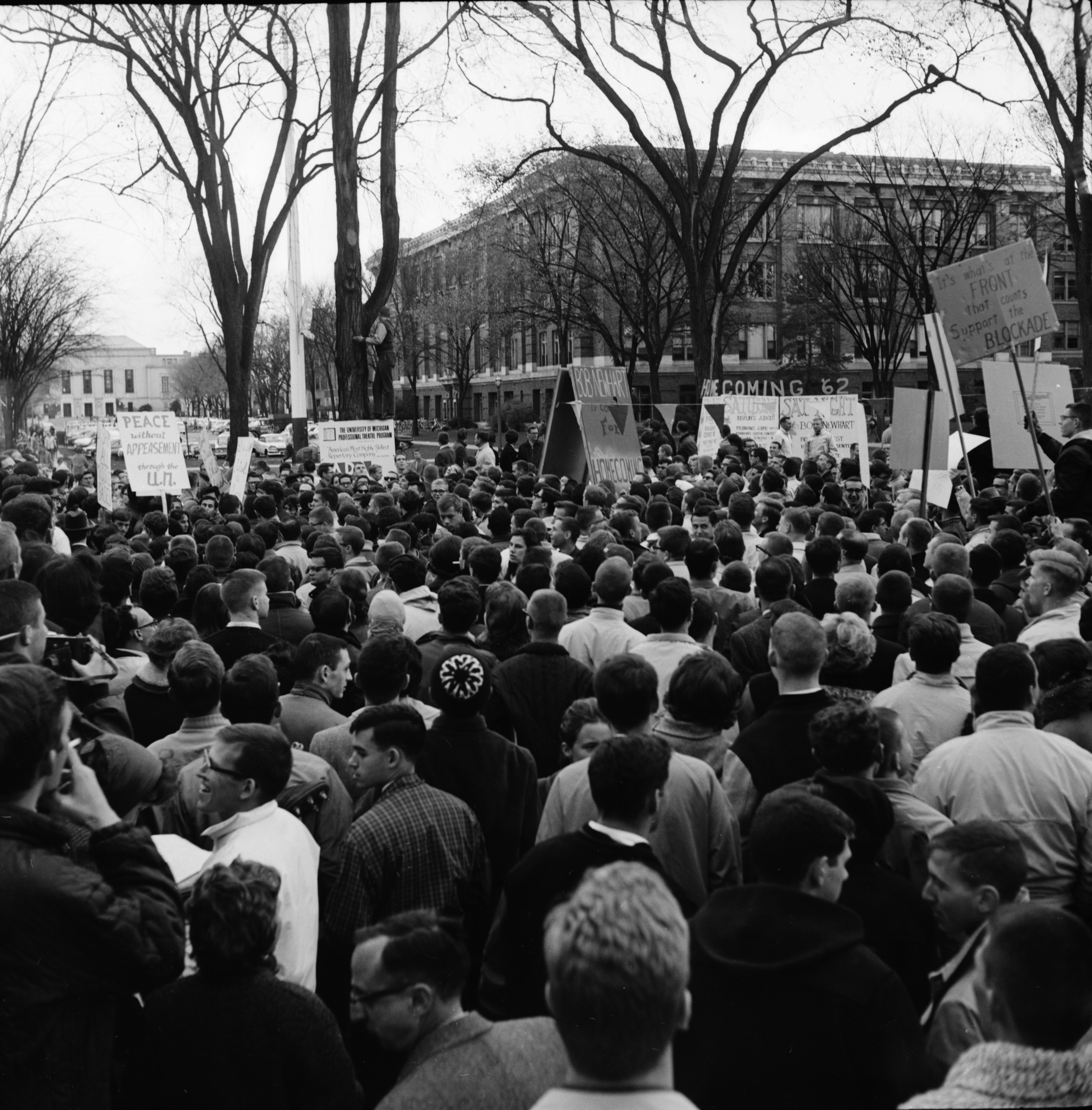 Demonstrators for and against America's Cuban blockade on the University of Michigan Diag, October 25, 1962 image