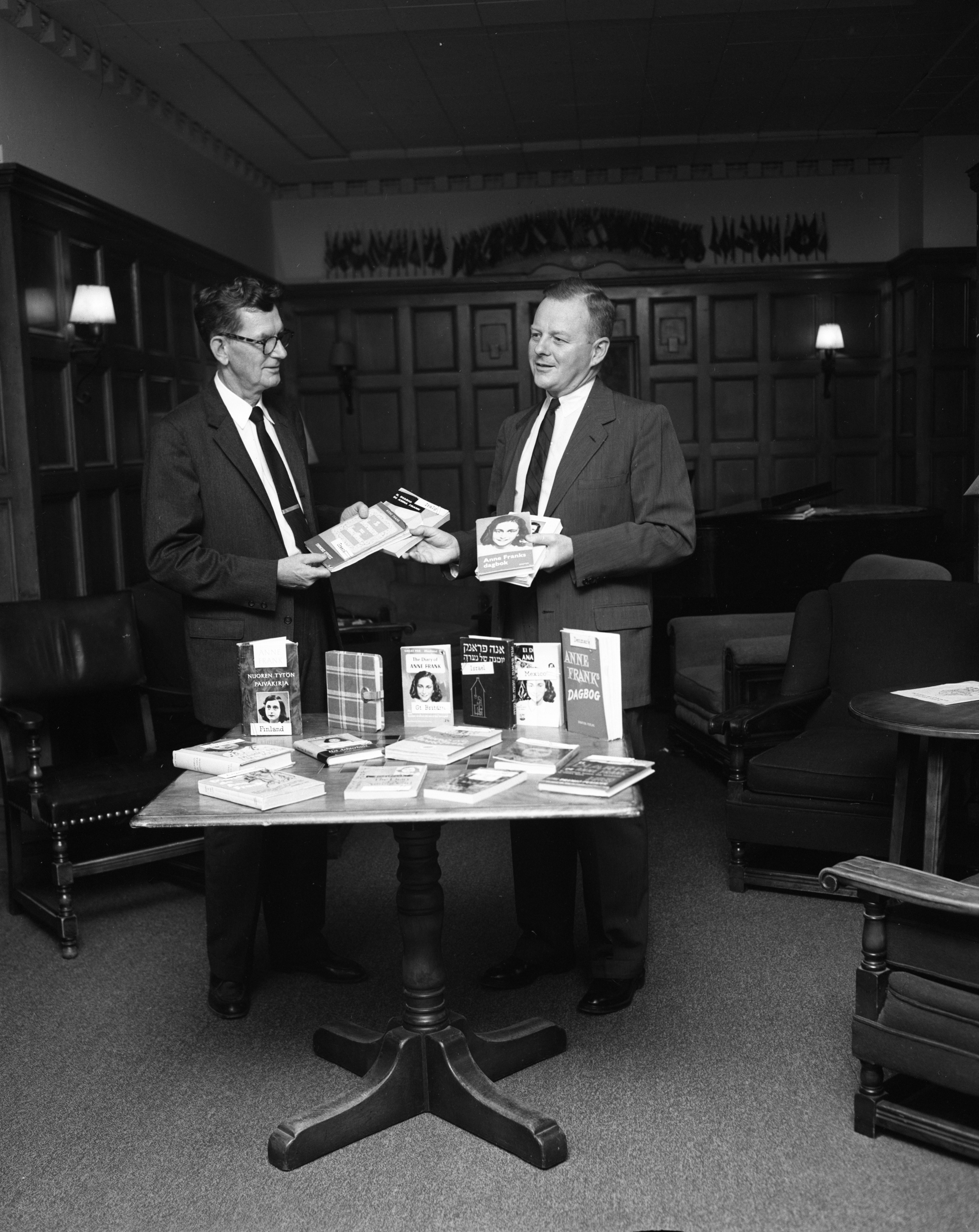 Michigan Theater's Gerald Hoag presents books to Dr. James M. Davis of the University's International Center, September 1959 image