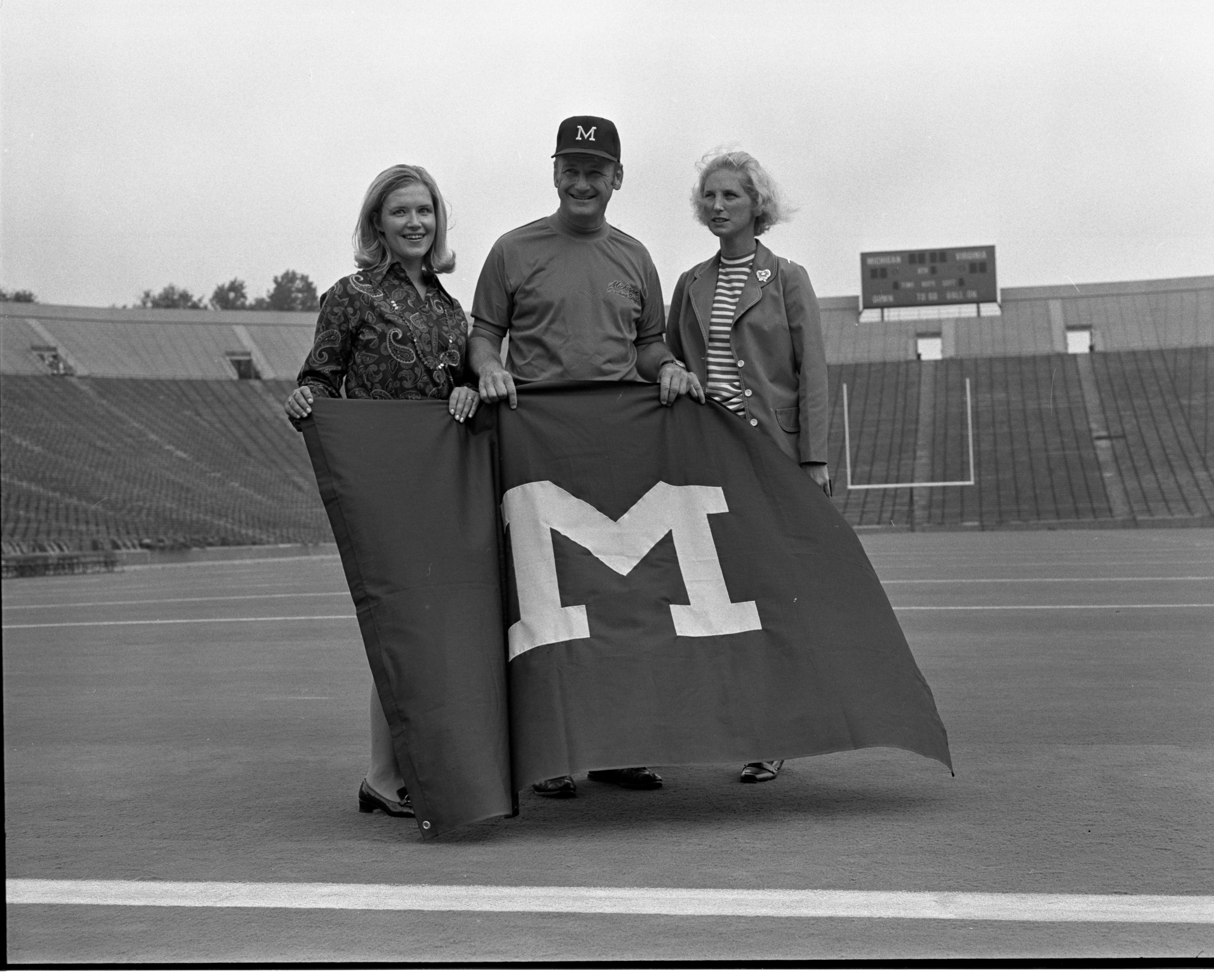 Bo Schembechler With 'M' Flags That Will Be Sold To Raise Funds for Scholarships, September 1971 image