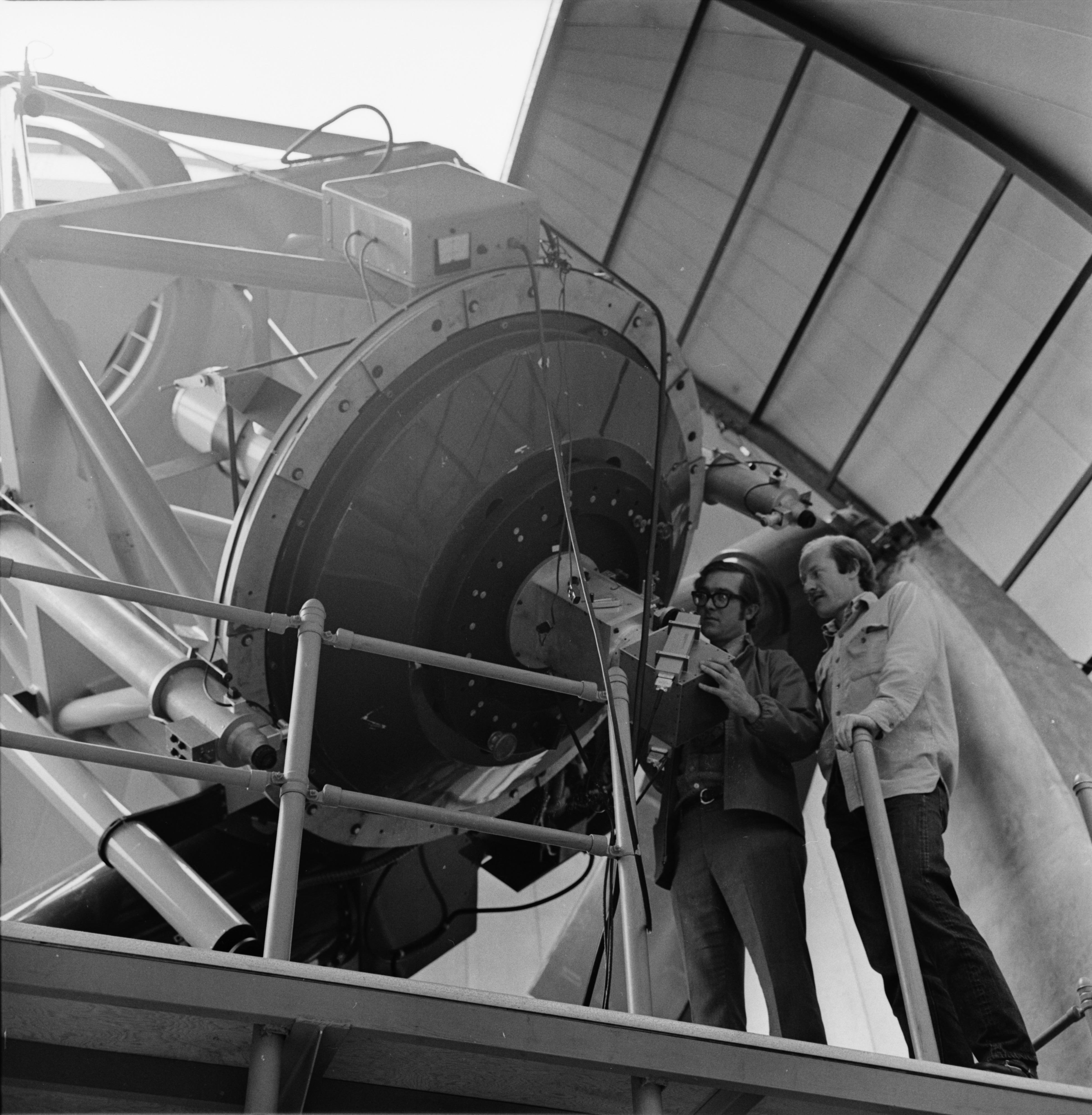 Dr. William L. Williams and Larry D. Petro, of the U-M Astronomy and Physics departments, work together at Stinchfield Woods Observatory, May 1972 image