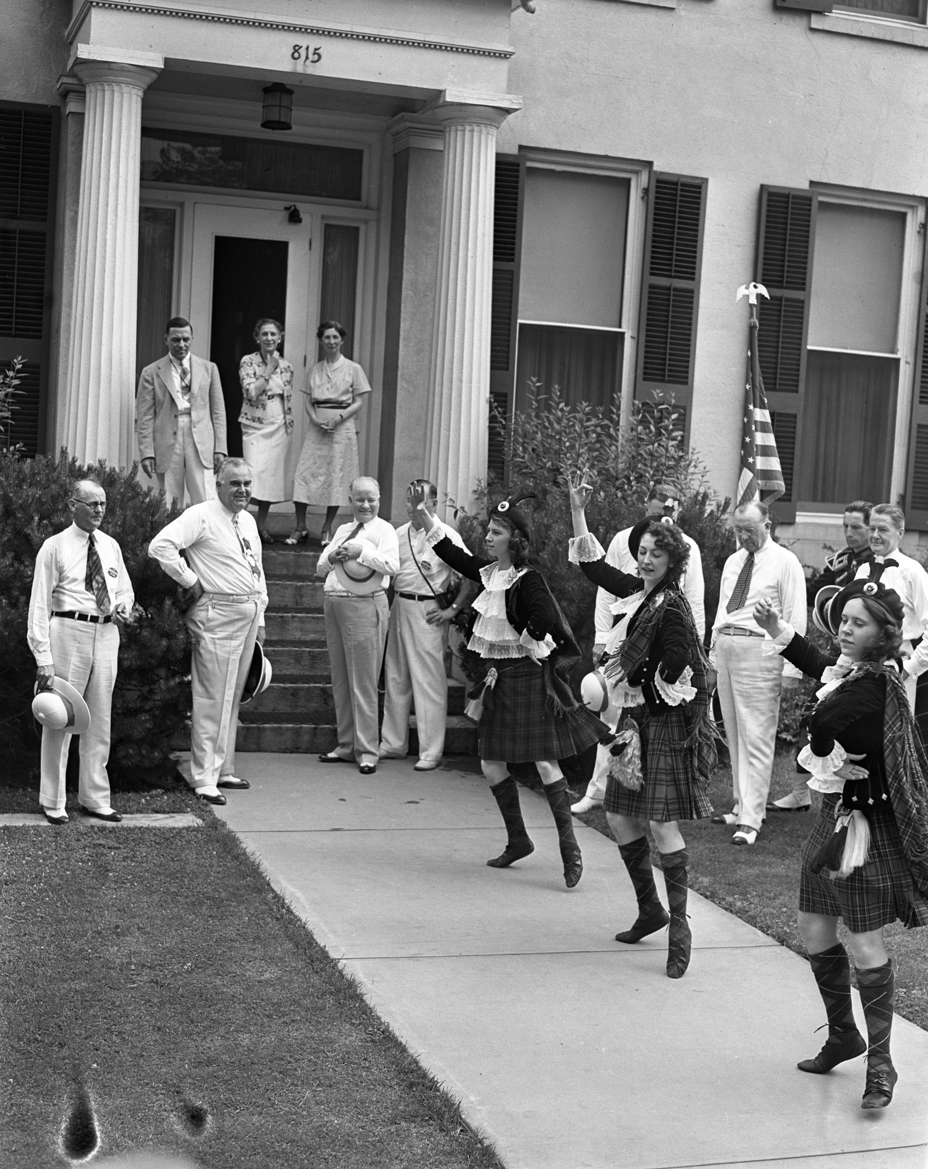 Scottish dancers perform in front of the University of Michigan's President's House for reunion class of 1909, June 1939 image
