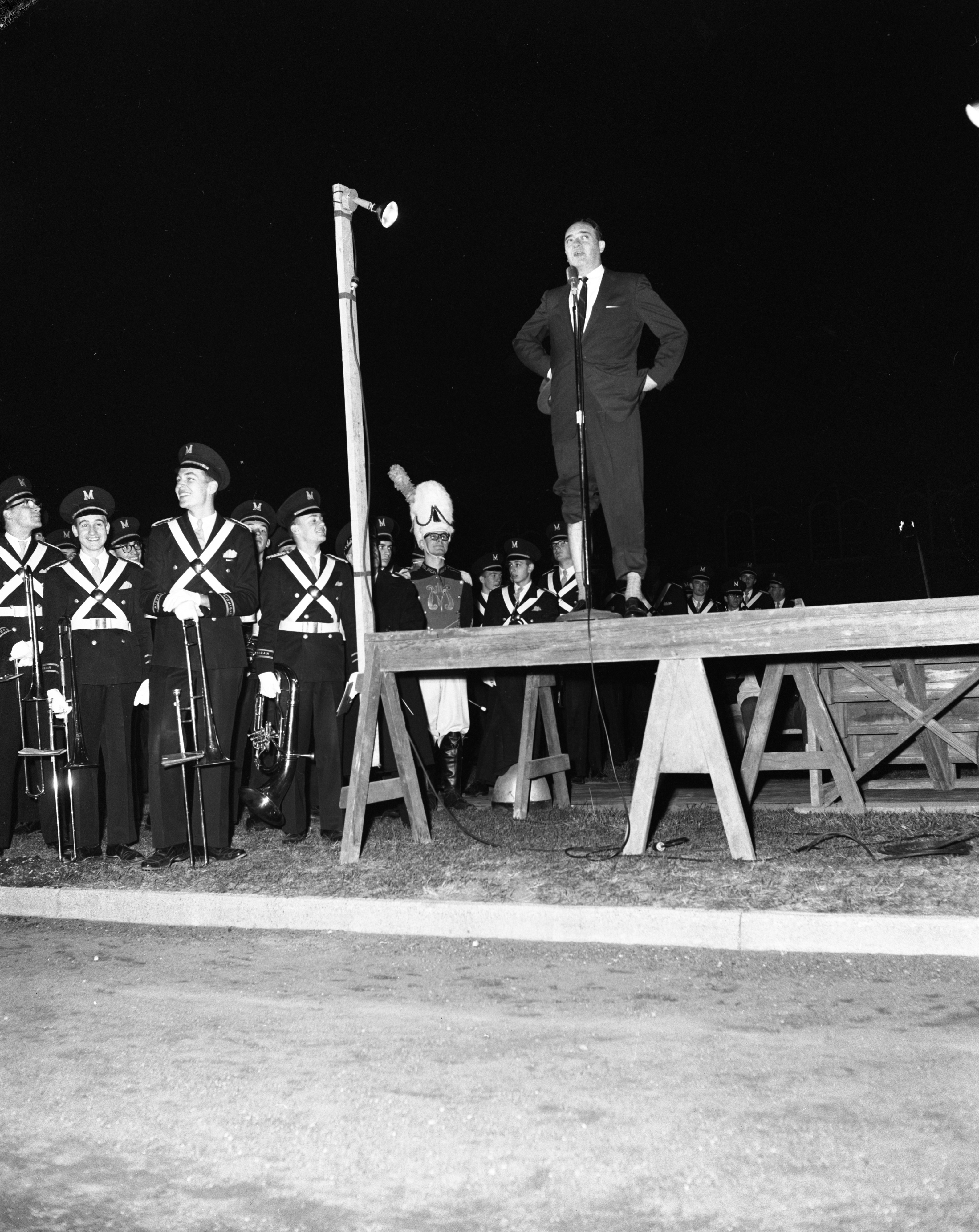 Sportscaster Mel Allen joins the University of Michigan Band for a pep rally, November 1958 image