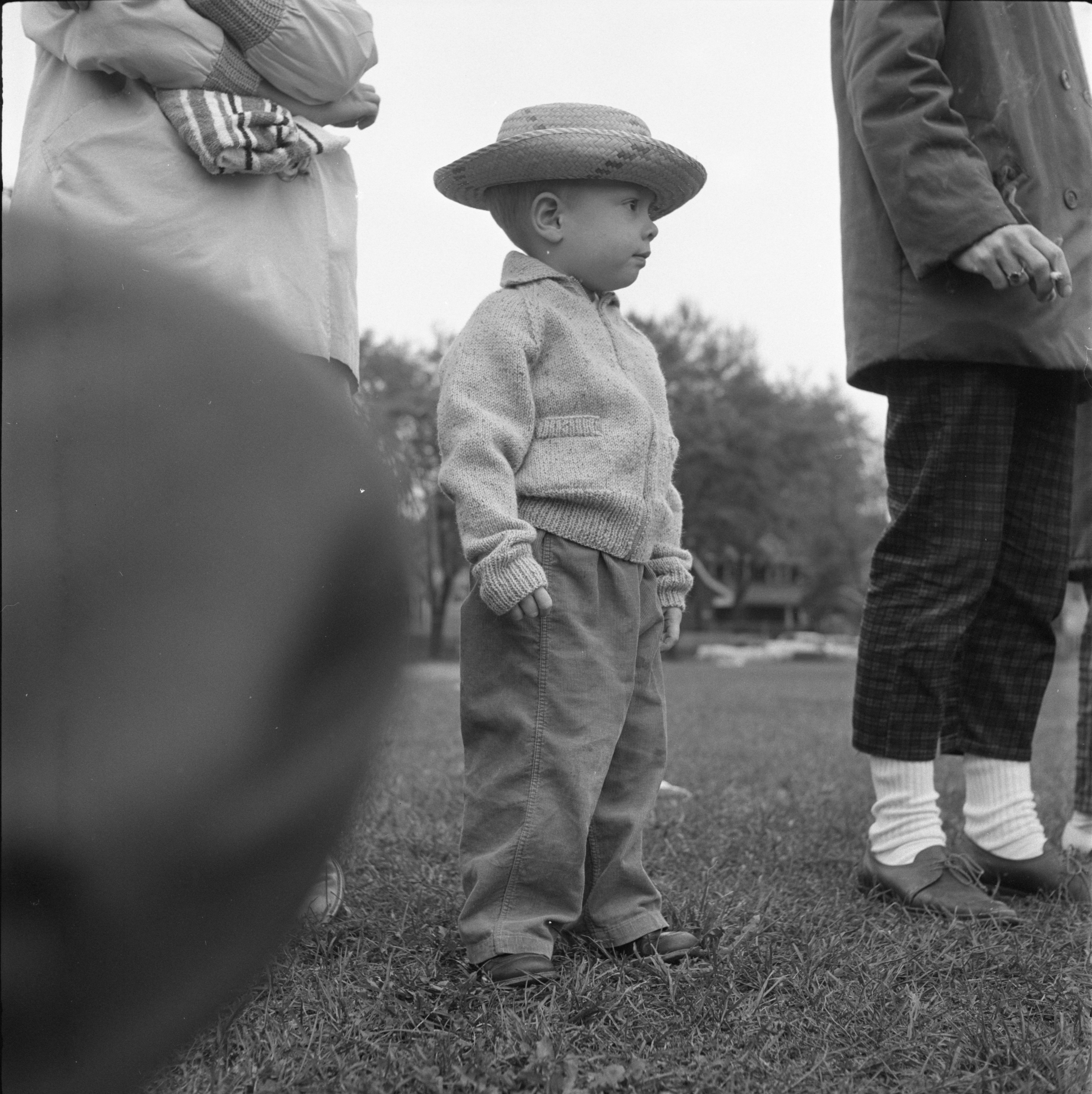 A Young Fan Watches The University of Michigan Marching Band Practice, October 1959 image