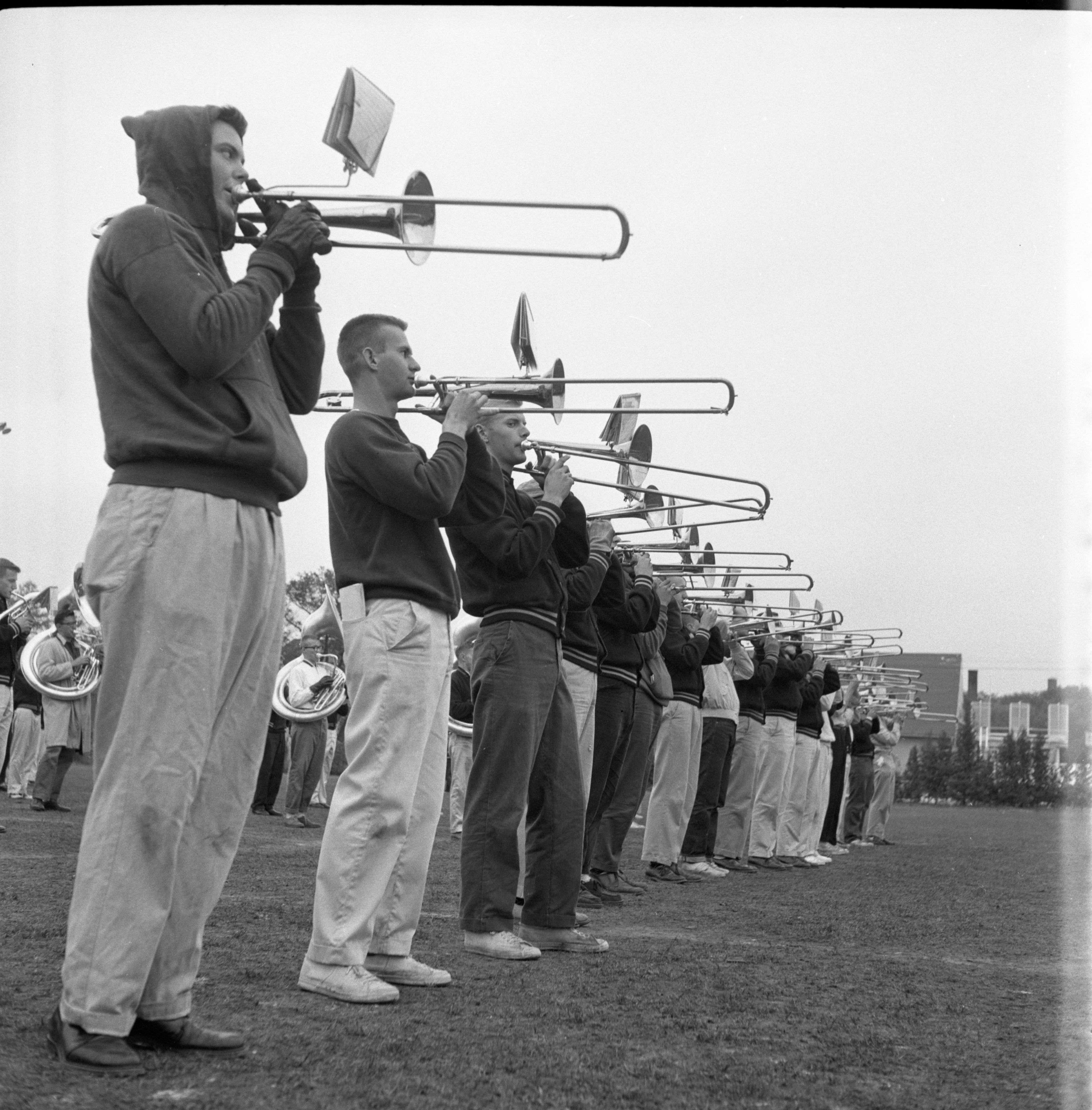 Trombone Players Line Up At University of Michigan Marching Band Practice, October 1959 image