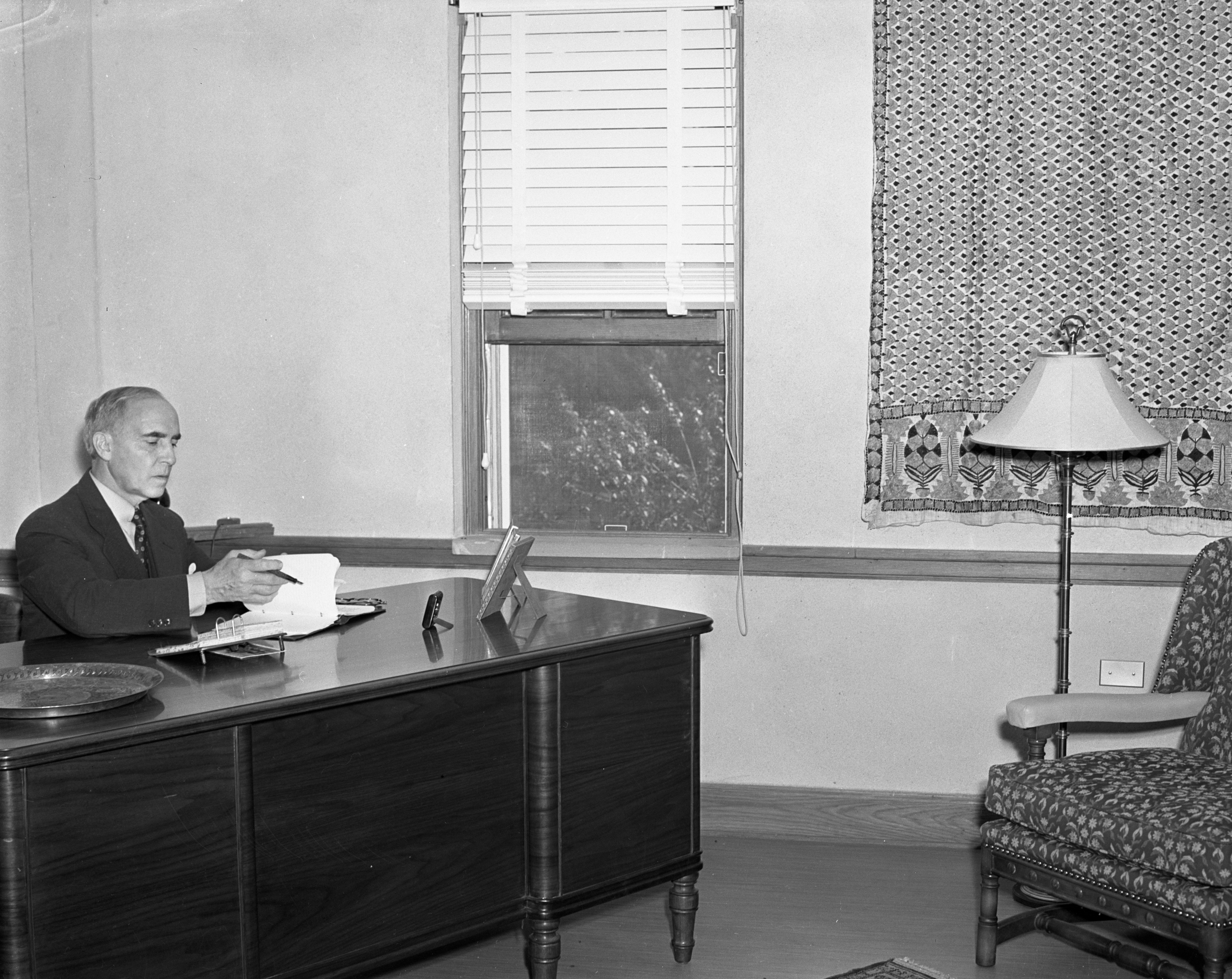 Director J. Raleigh Nelson at his desk, University of Michigan International Center, 1938 image