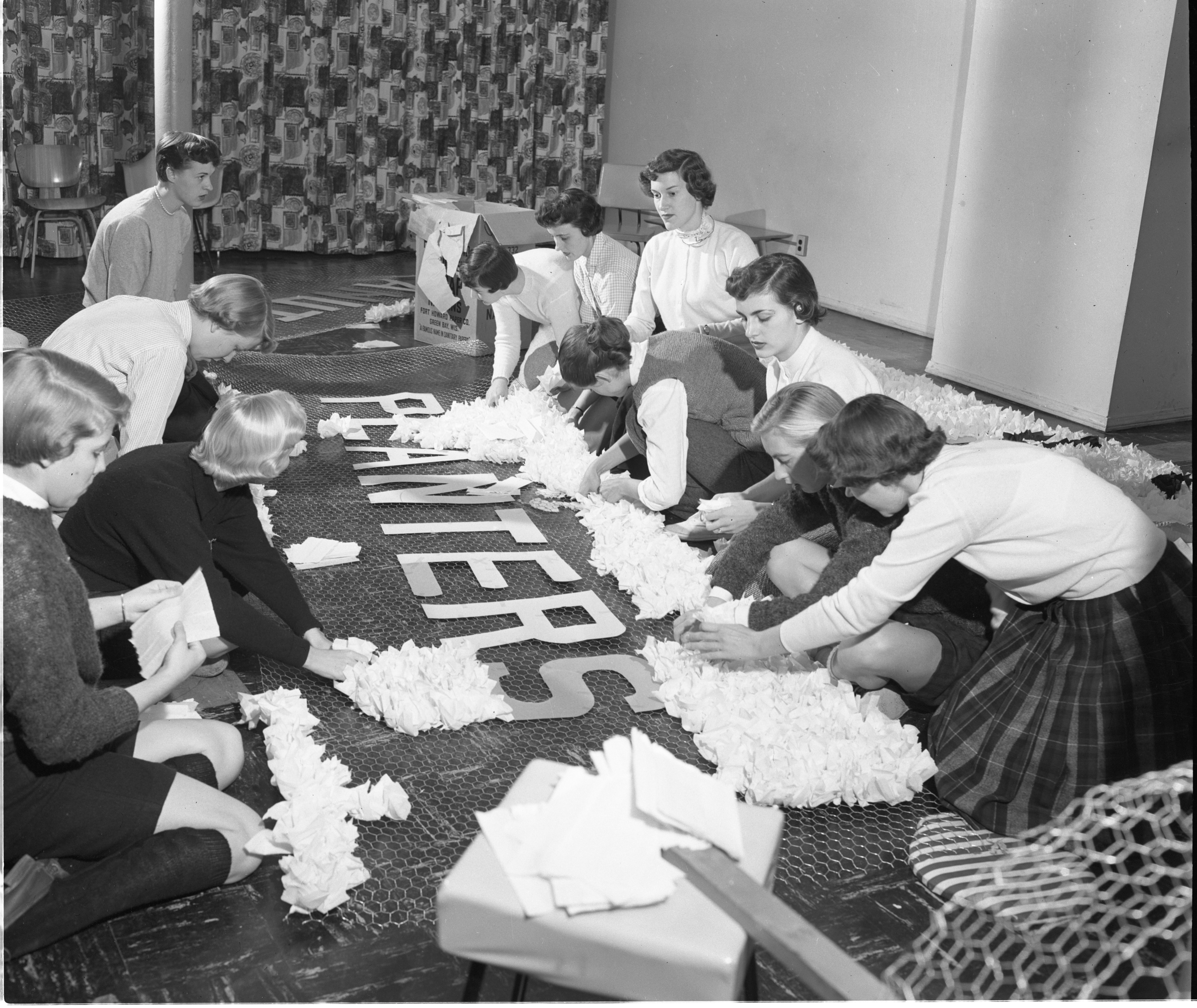 Alpha Delta Pi Sorority Sisters Work On Their Homecoming Display, October 1955 image