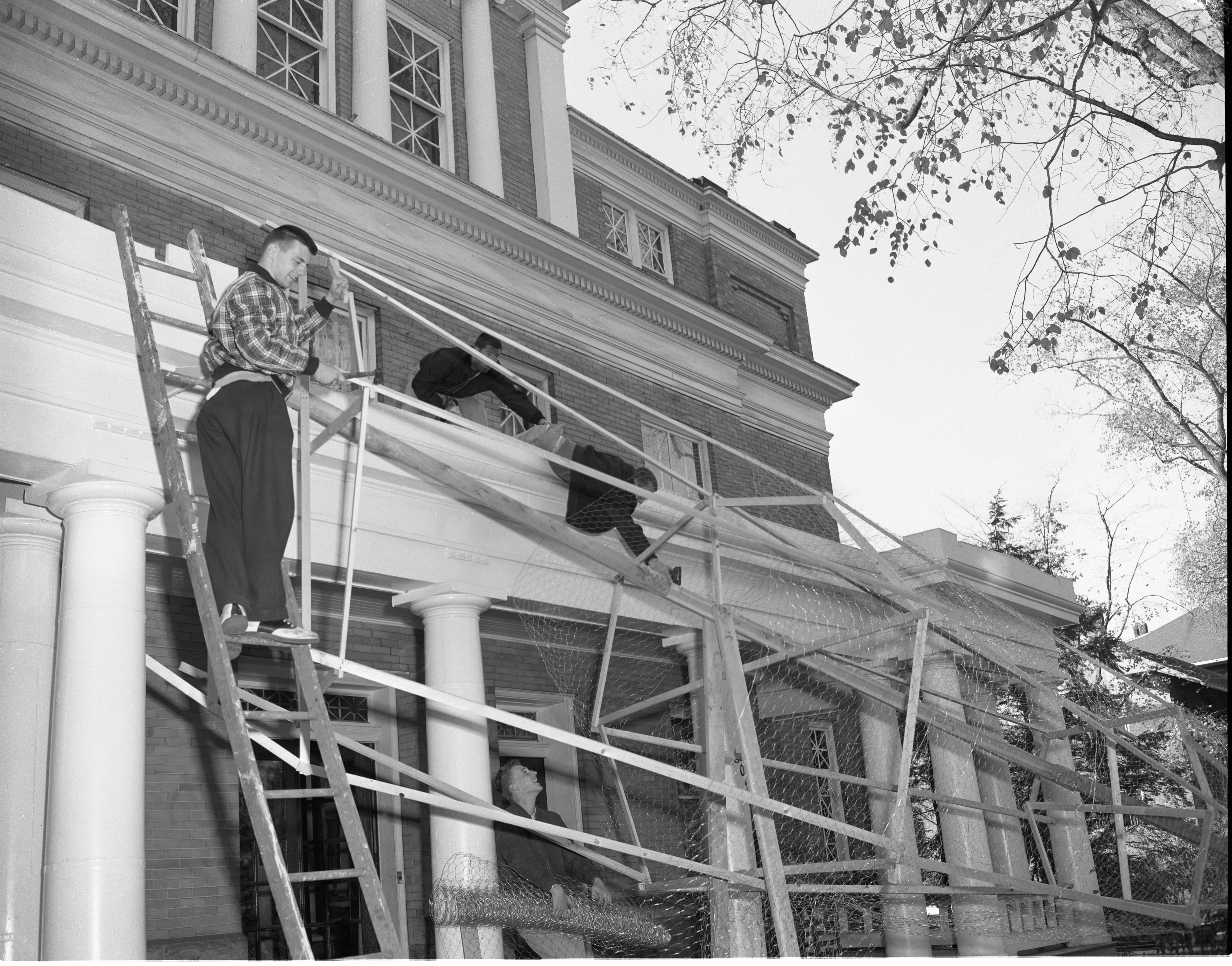 Beta Theta Pi Fraternity Brothers Construct Their Homecoming Display, October 1955 image