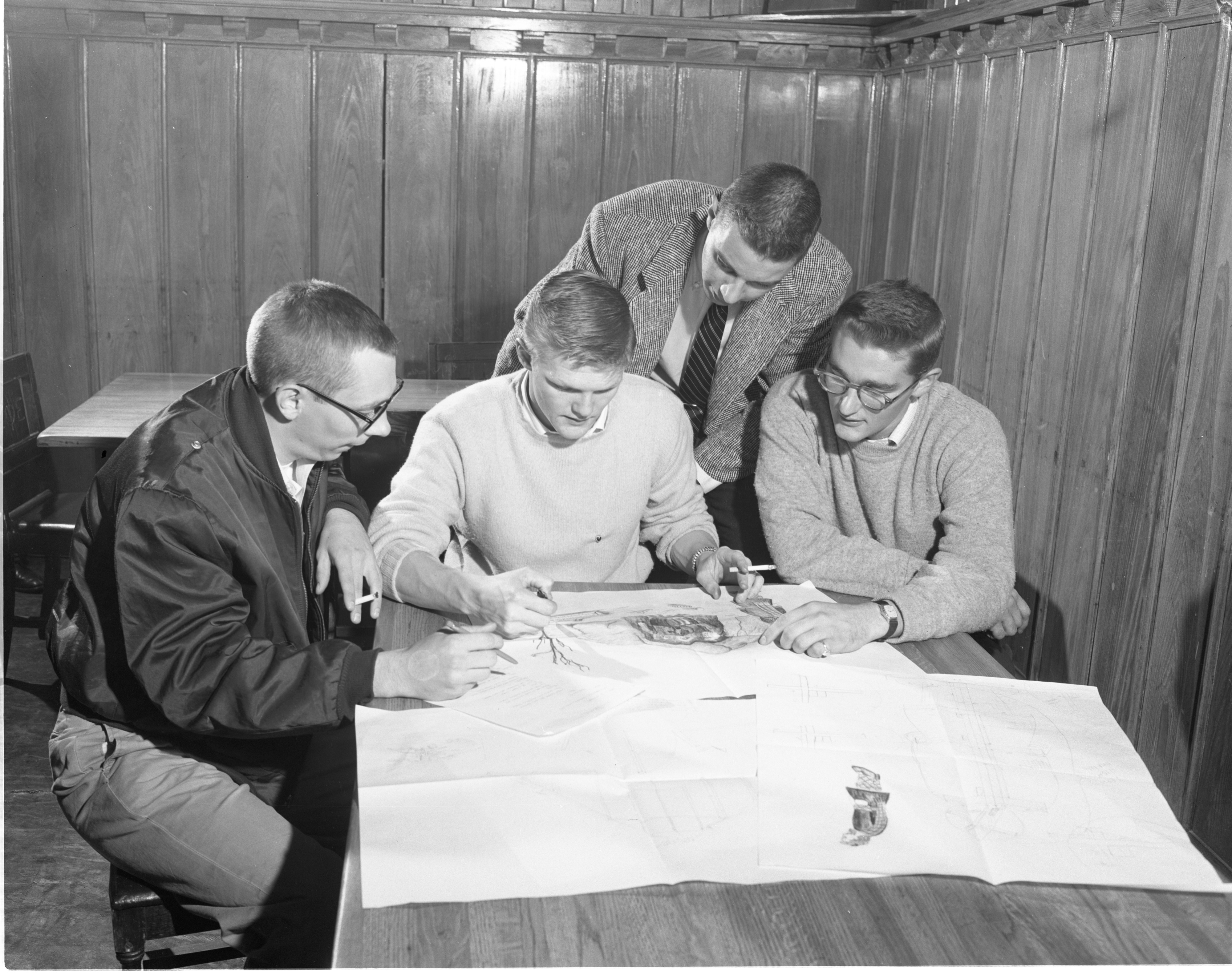 Sigma Phi Epsilon Fraternity Brothers Plan Their Homecoming Display, October 1955 image