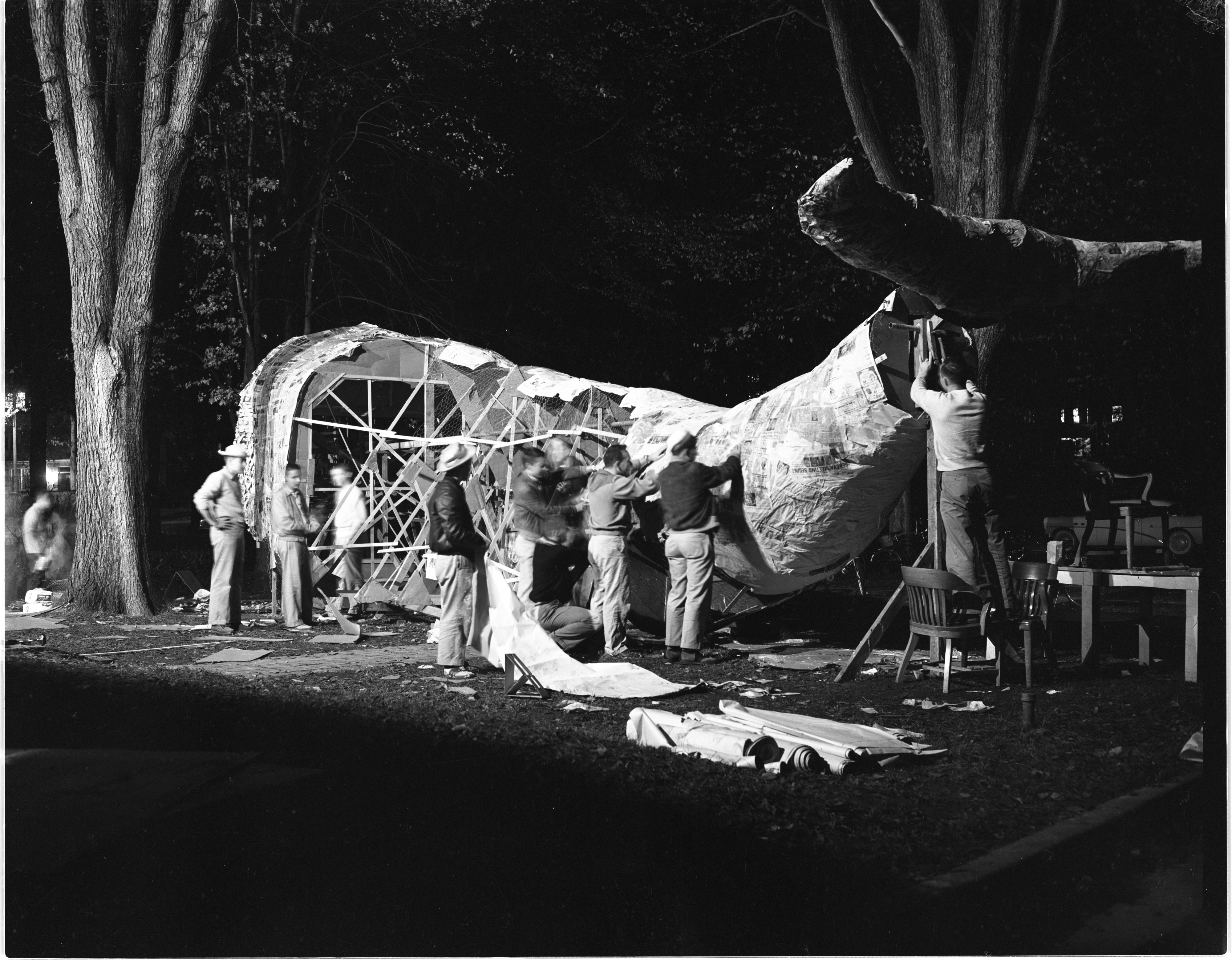 Alpha Sigma Phi Fraternity Brothers Construct Their Homecoming Display, October 1955 image