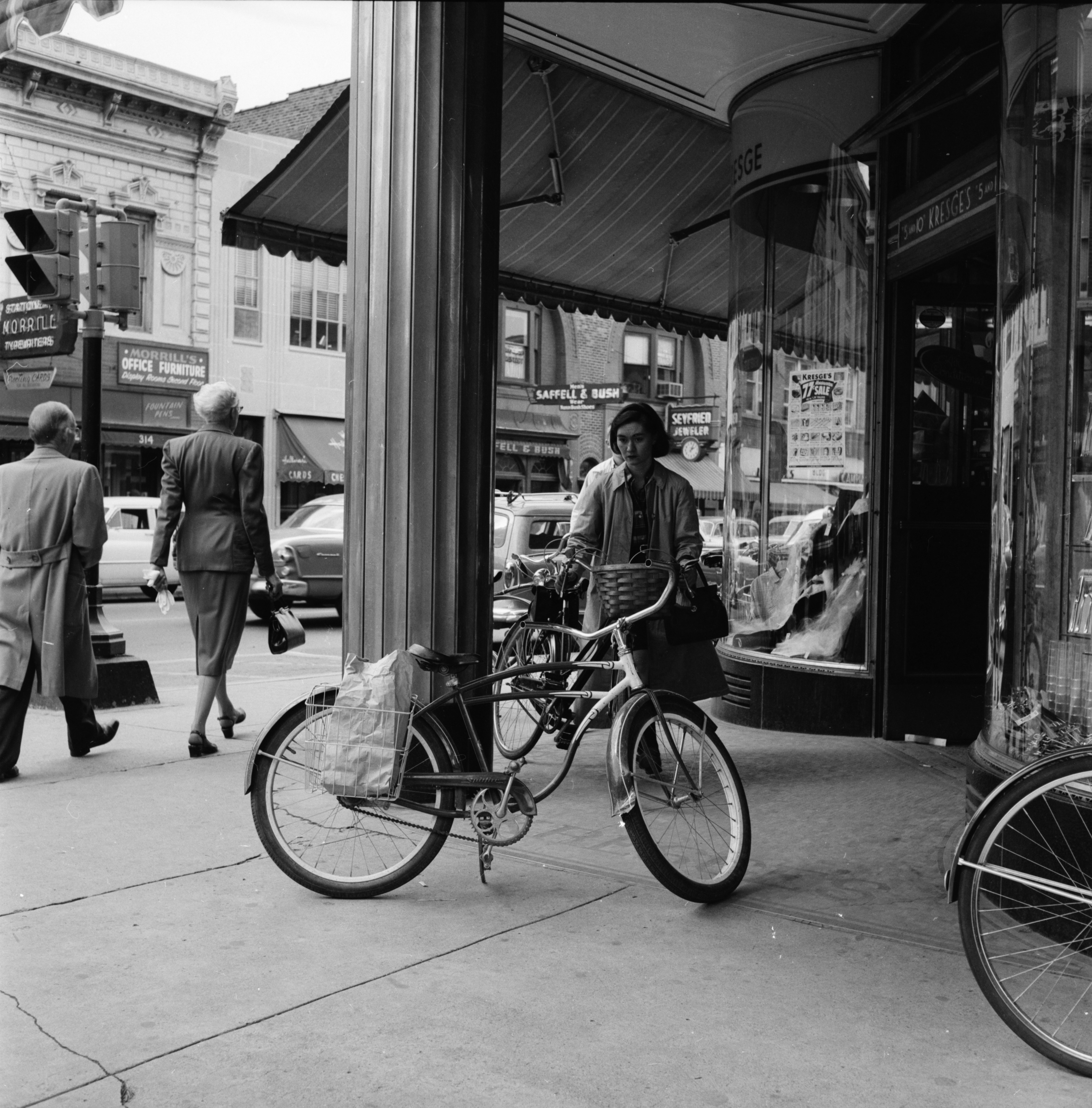 Bicycles parked along State Street on University of Michigan campus, September 1956 image