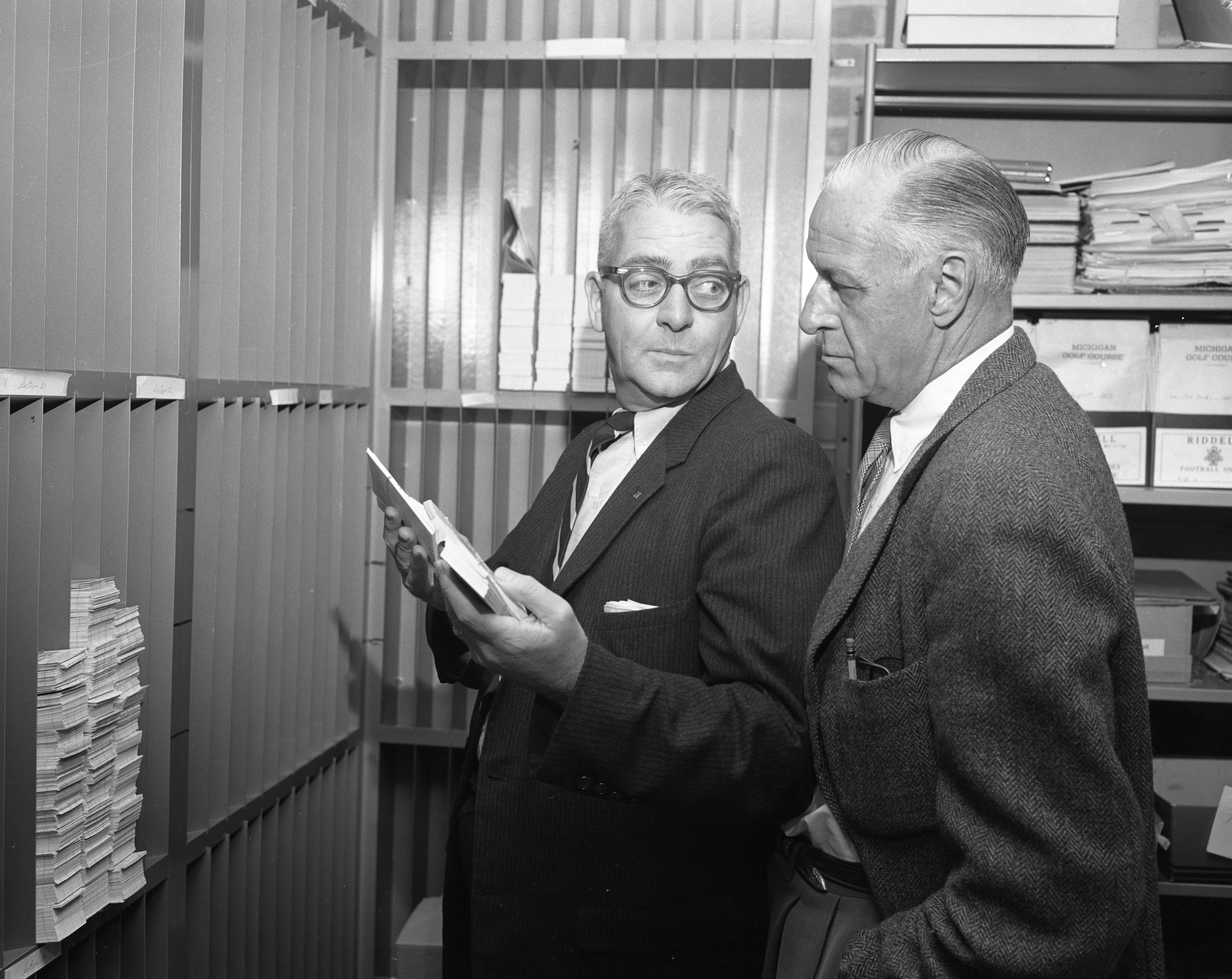 Don Weir and Fritz Crisler In University of Michigan Athletics Ticket Vault, October 1957 image