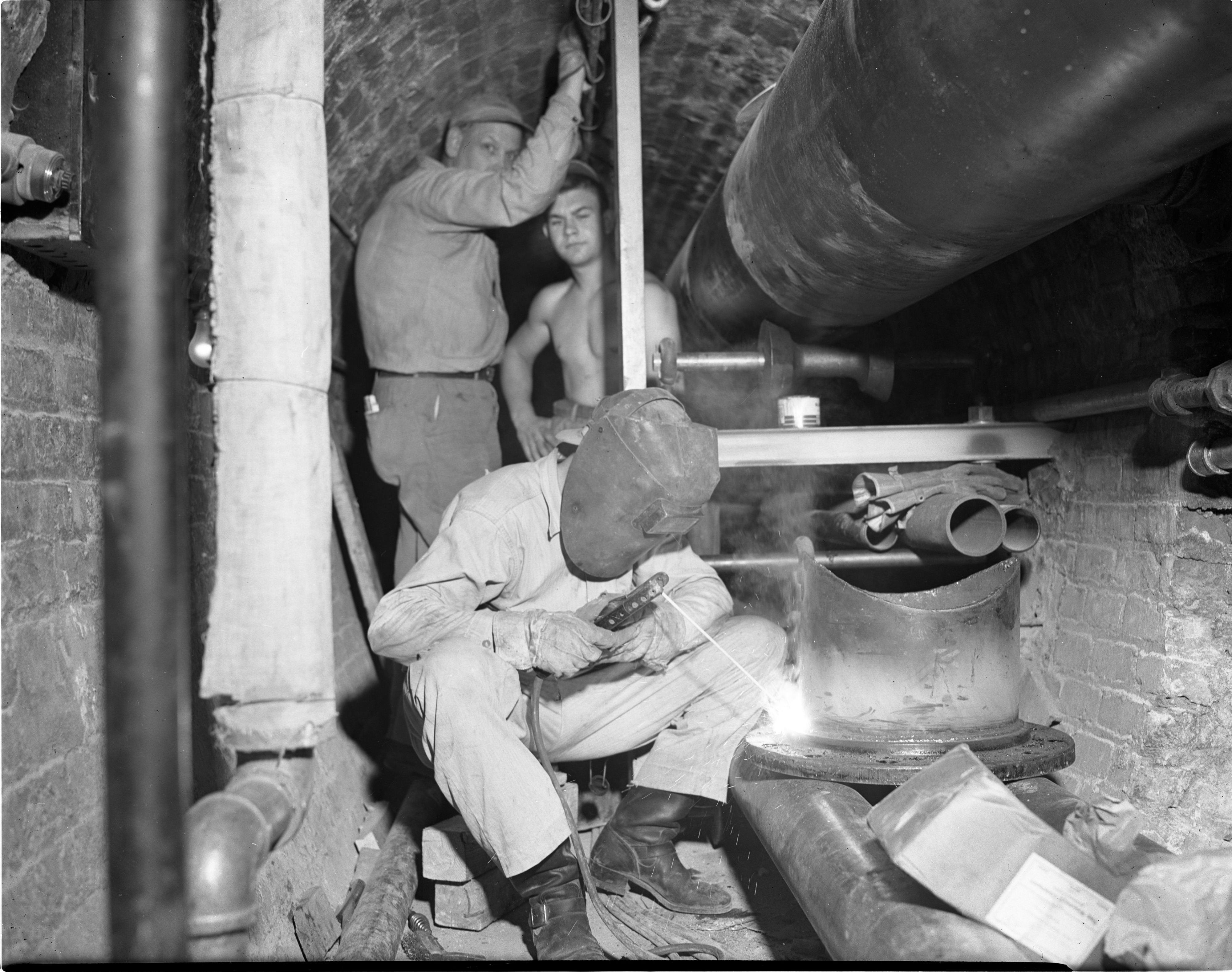 Workers In U-M Underground Tunnels, August 7, 1947 image
