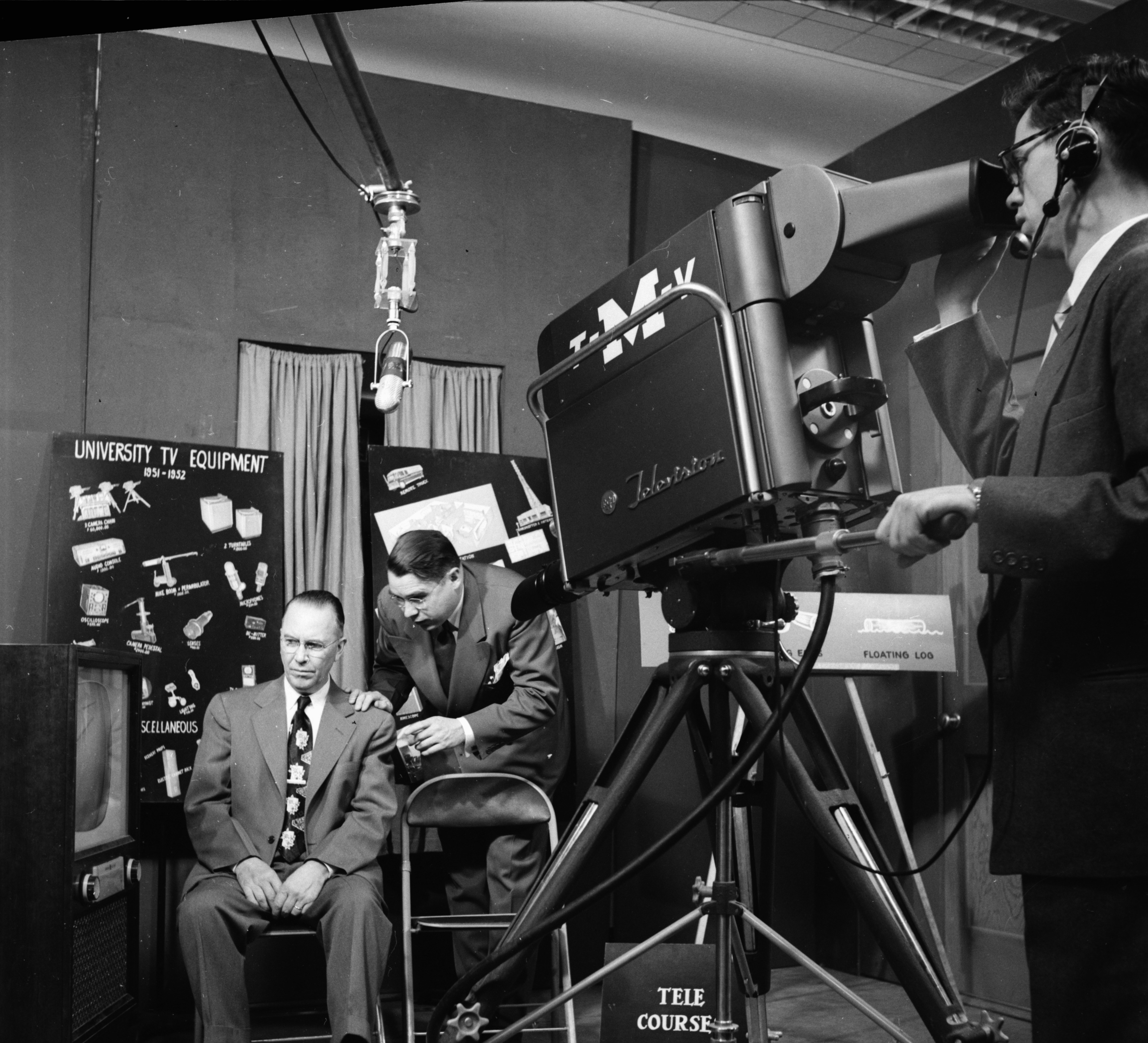 U-M Professor Garnet R. Garrison explains video production to E. Ray Baxter, assistant to the president of Grand Rapids Junior College, November 1952 image