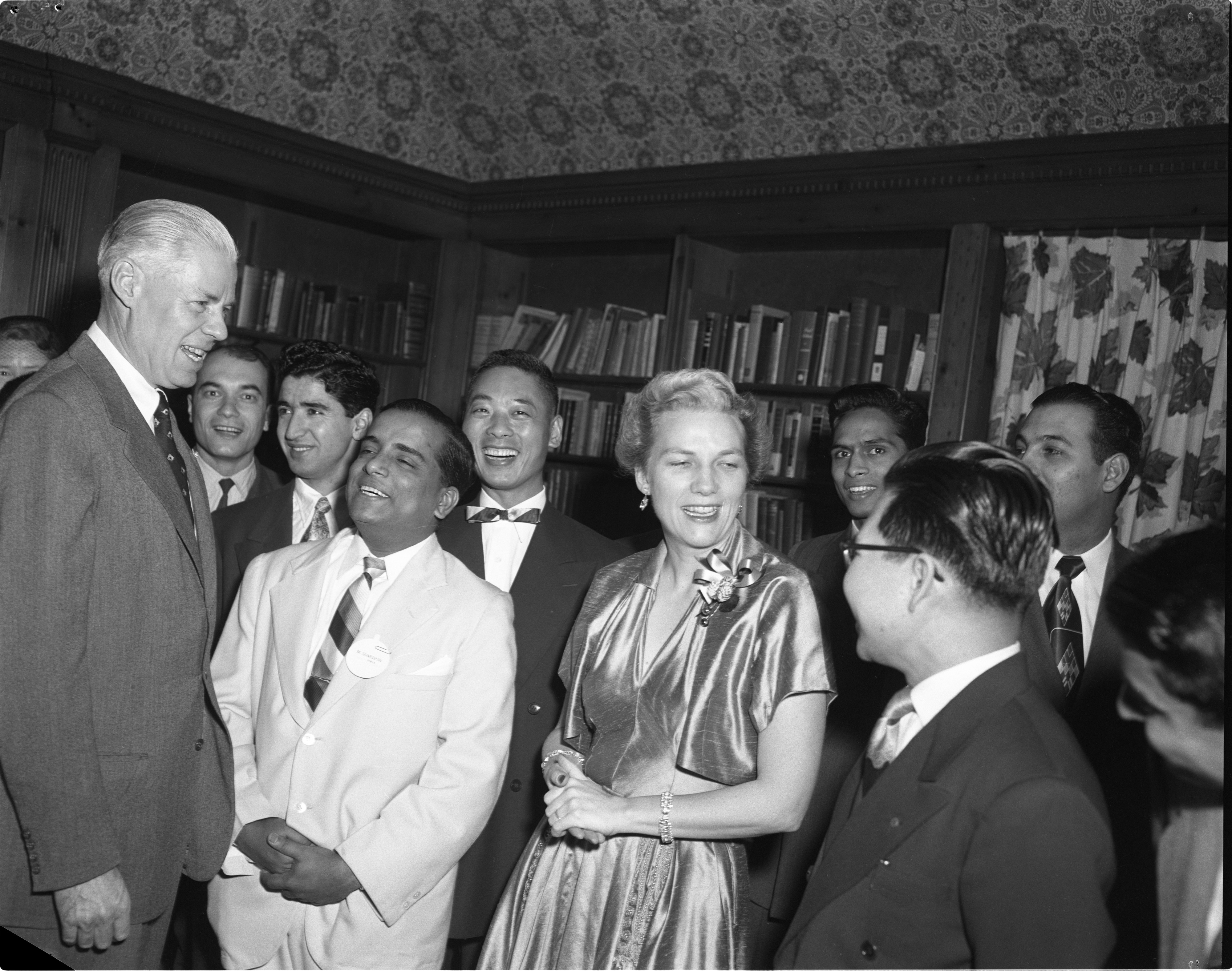 Mr. & Mrs. Hatcher With UM's Foreign Exchange Students At Christmas Reception, December 1952 image
