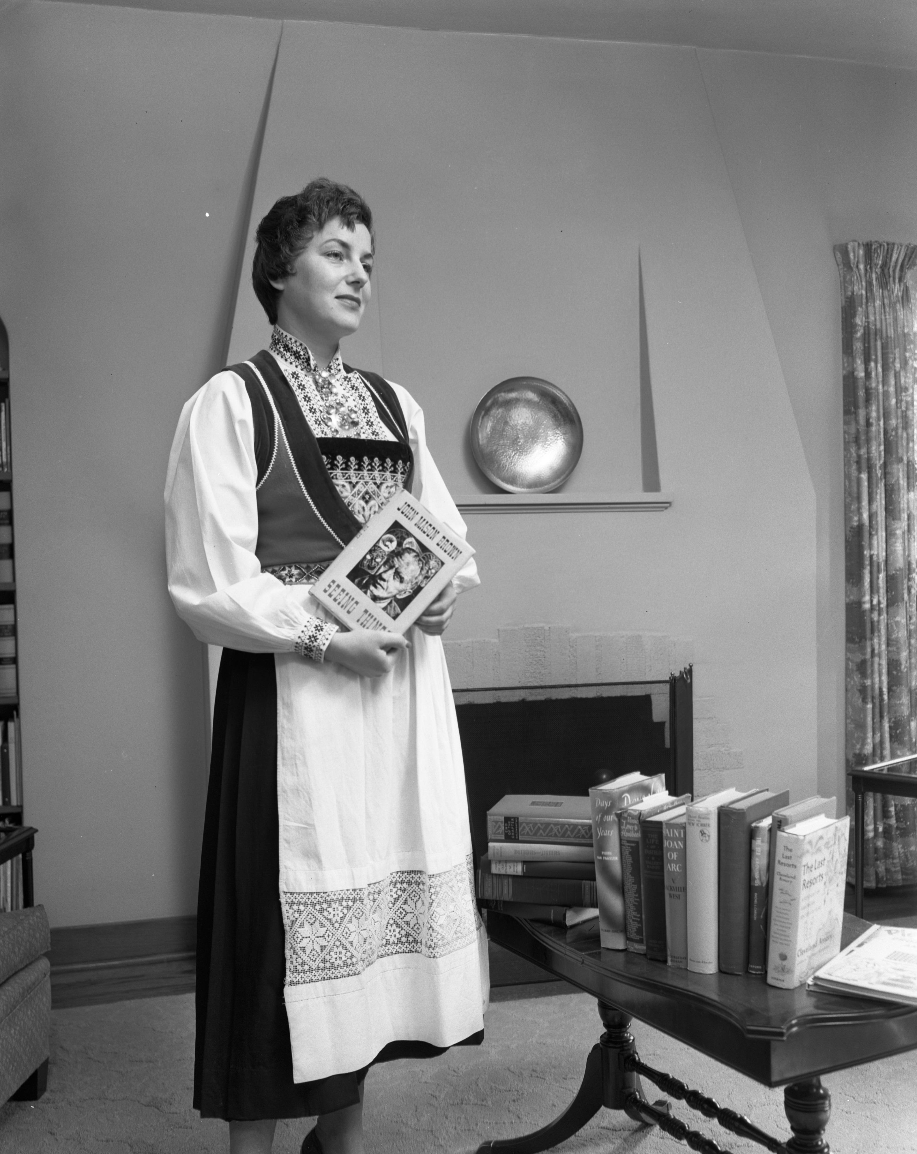 Borghild Holter With Books For Sale To Help Fund AAUW Fellowships, November 1, 1955 image