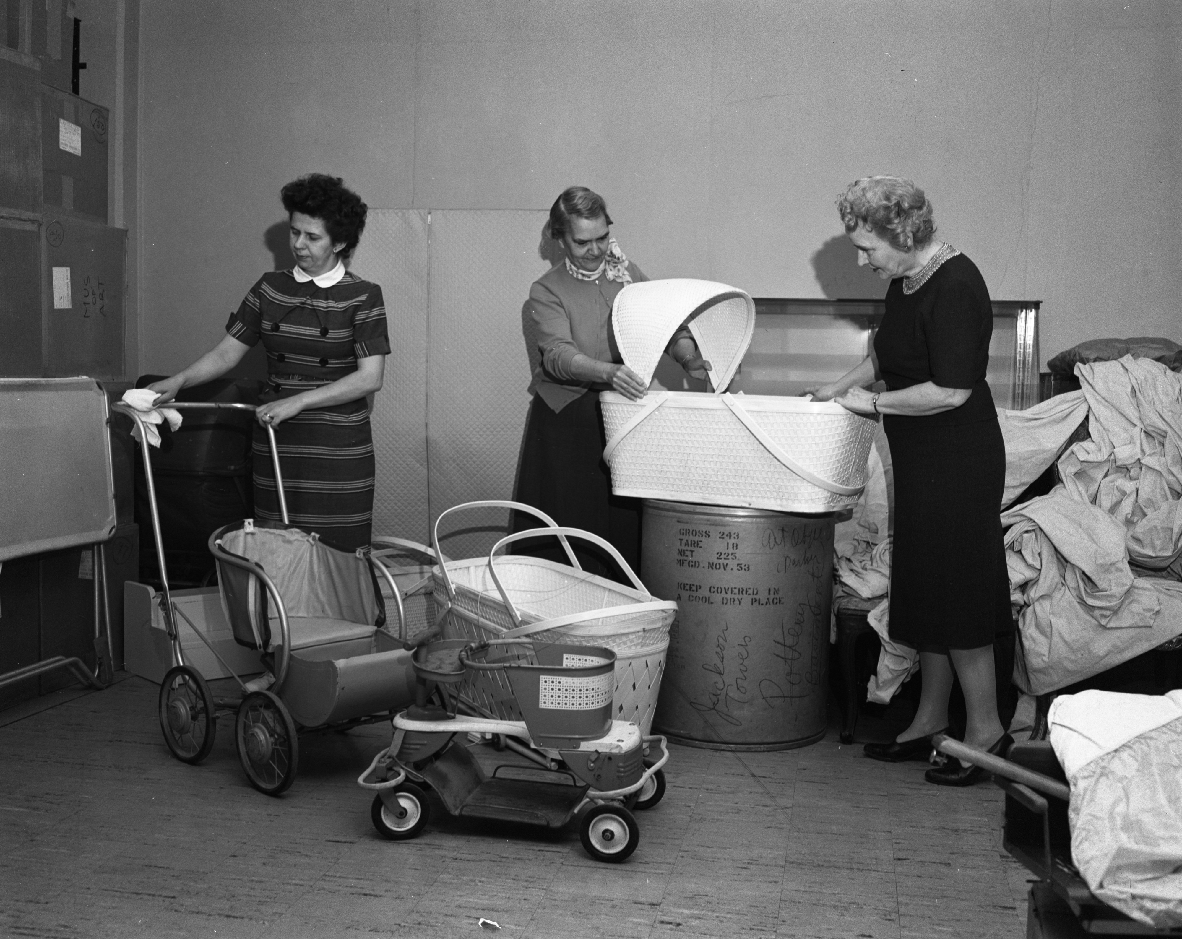 Members Of The Neighbors, Lending Service For UM Students, Help Prepare To Move To Madelon Pound House, January 27, 1960 image