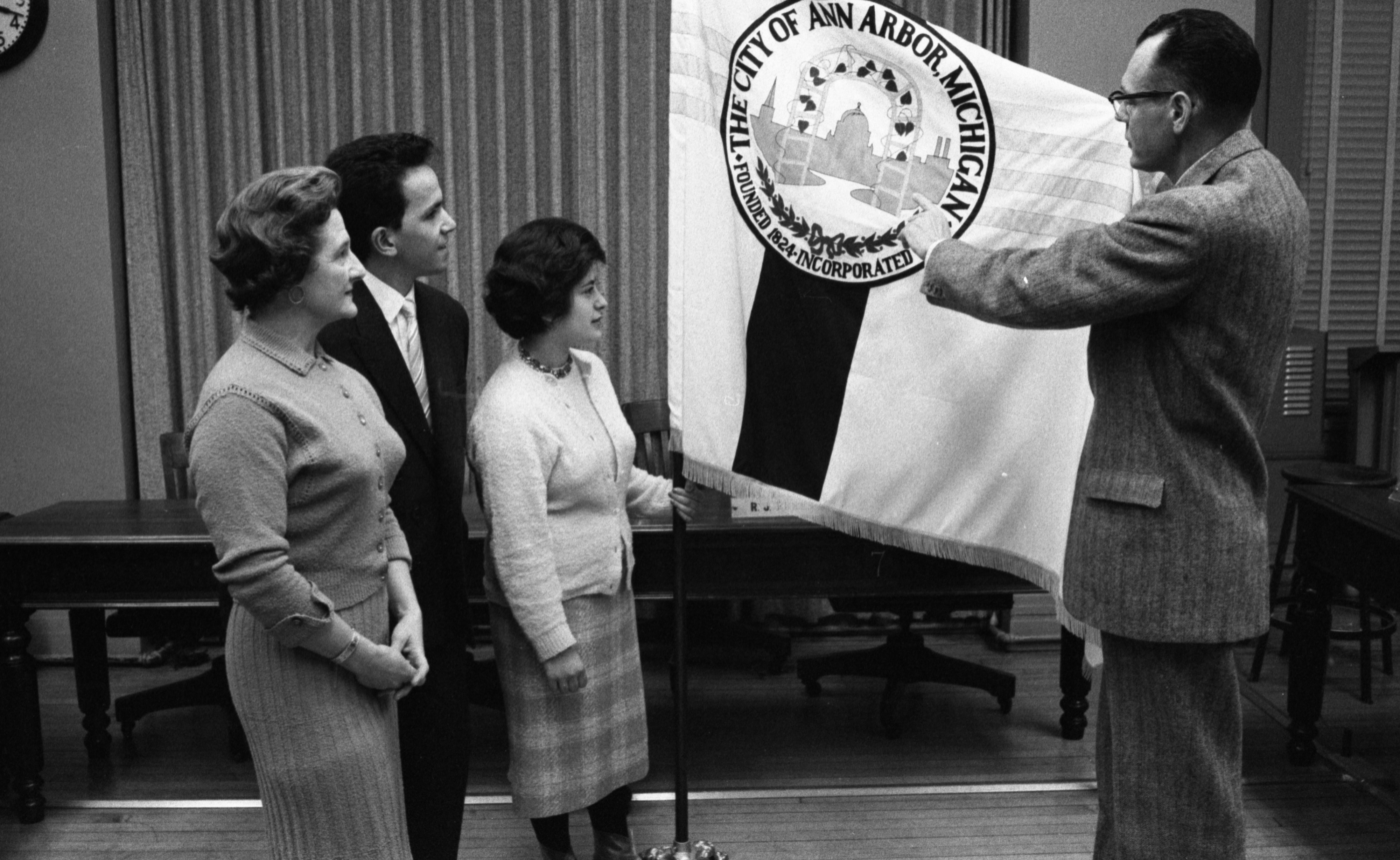 Mayor Pro-Tem, Russell J. Burns Shows City Flag To UM International Students Visiting City Hall, March 1, 1960 image