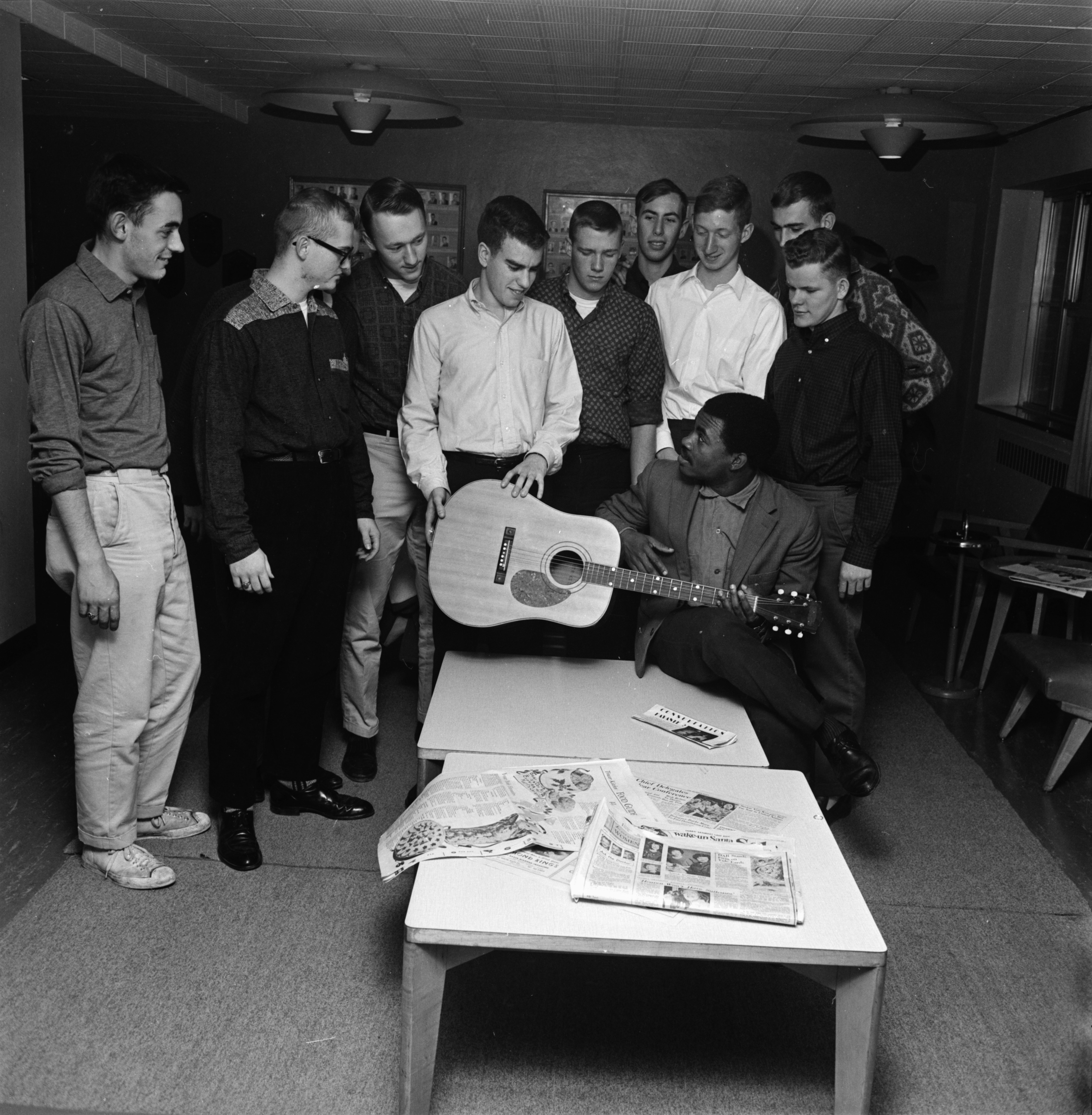 Felix Moukoko Ndoumbe, U-M student, receives an electric guitar from students in South Quad, December 1961 image