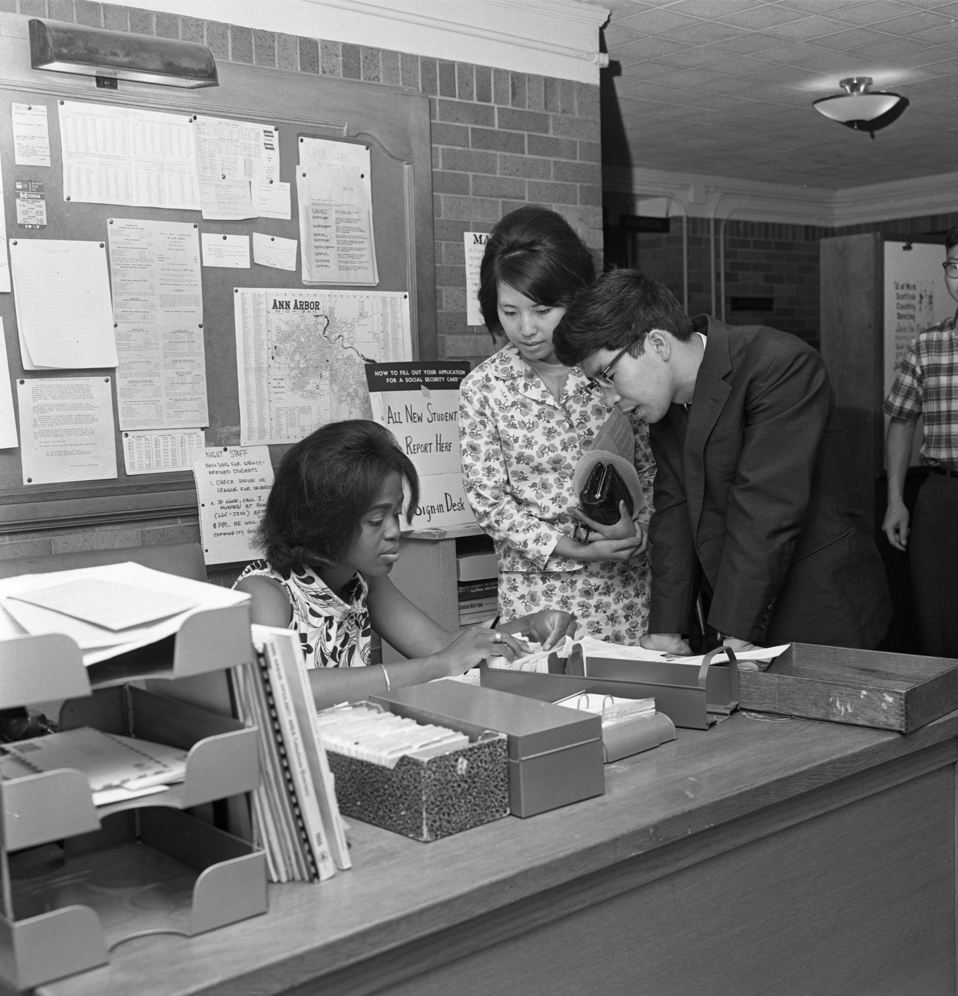 Iva Smith (left) Helps New UM Students From Japan Register For Campus Activities, August 31, 1967 image