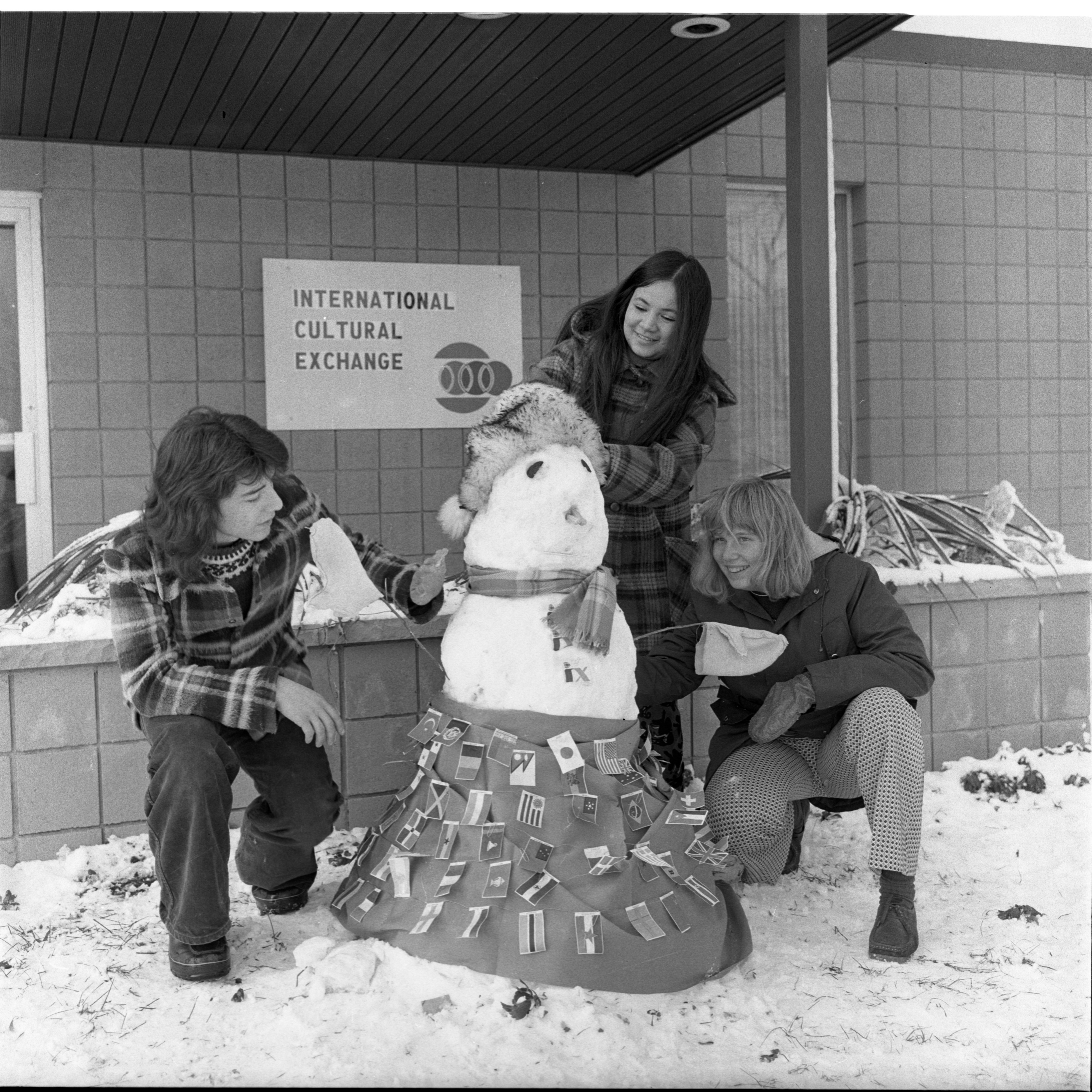 Students Build A Snow Woman In Front Of The International Cultural Exchange Building, December 19, 1973 image
