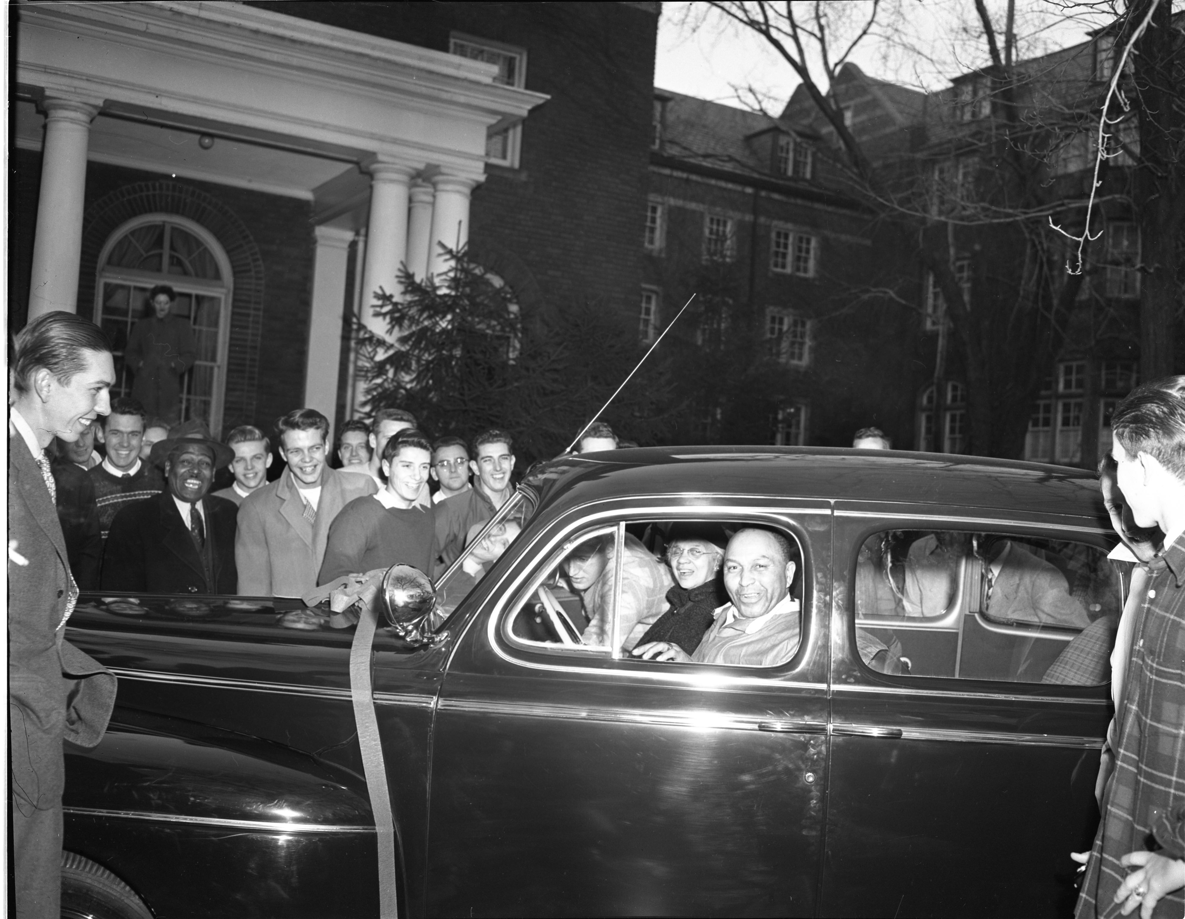 Sparky Harrison Receives A New Car As A Christmas Gift From Sigma Chi Fraternity, December 1946 image