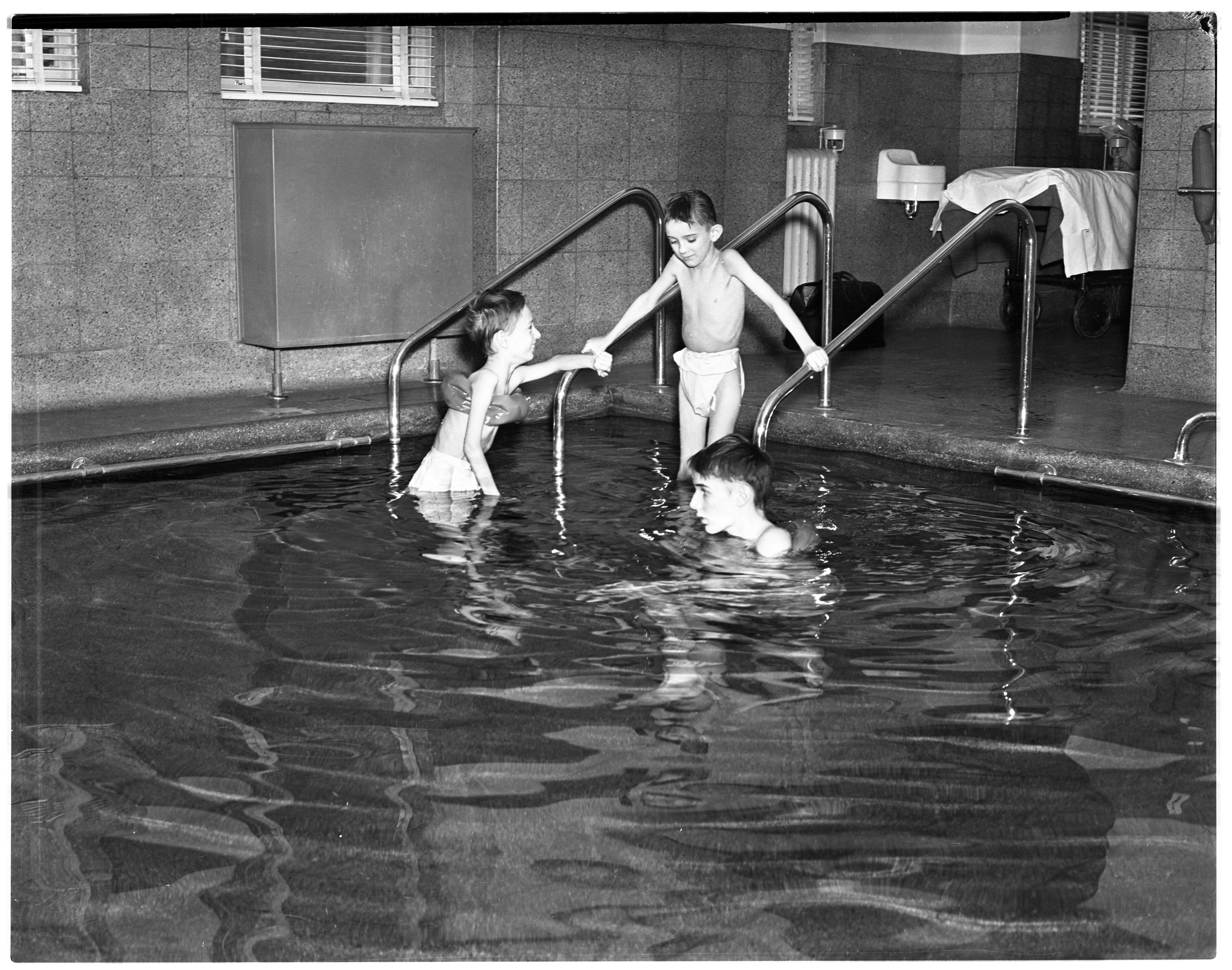 Polio Patients Exercise In University Hospital Physical Therapy Pool, January 1938 image