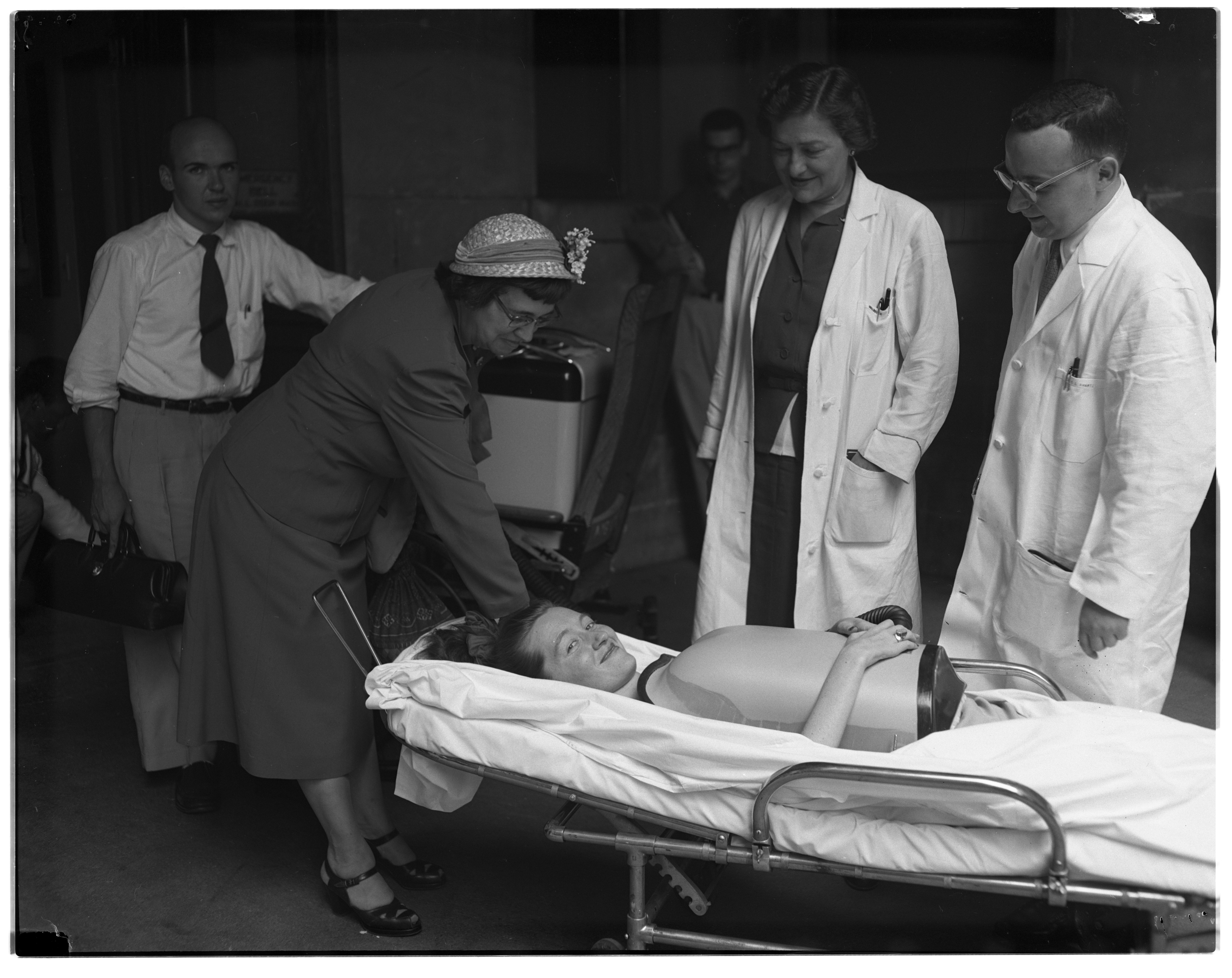 Marjorie Willock Arrives for Polio Respiratory Treatment at University Hospital, August 1953 image