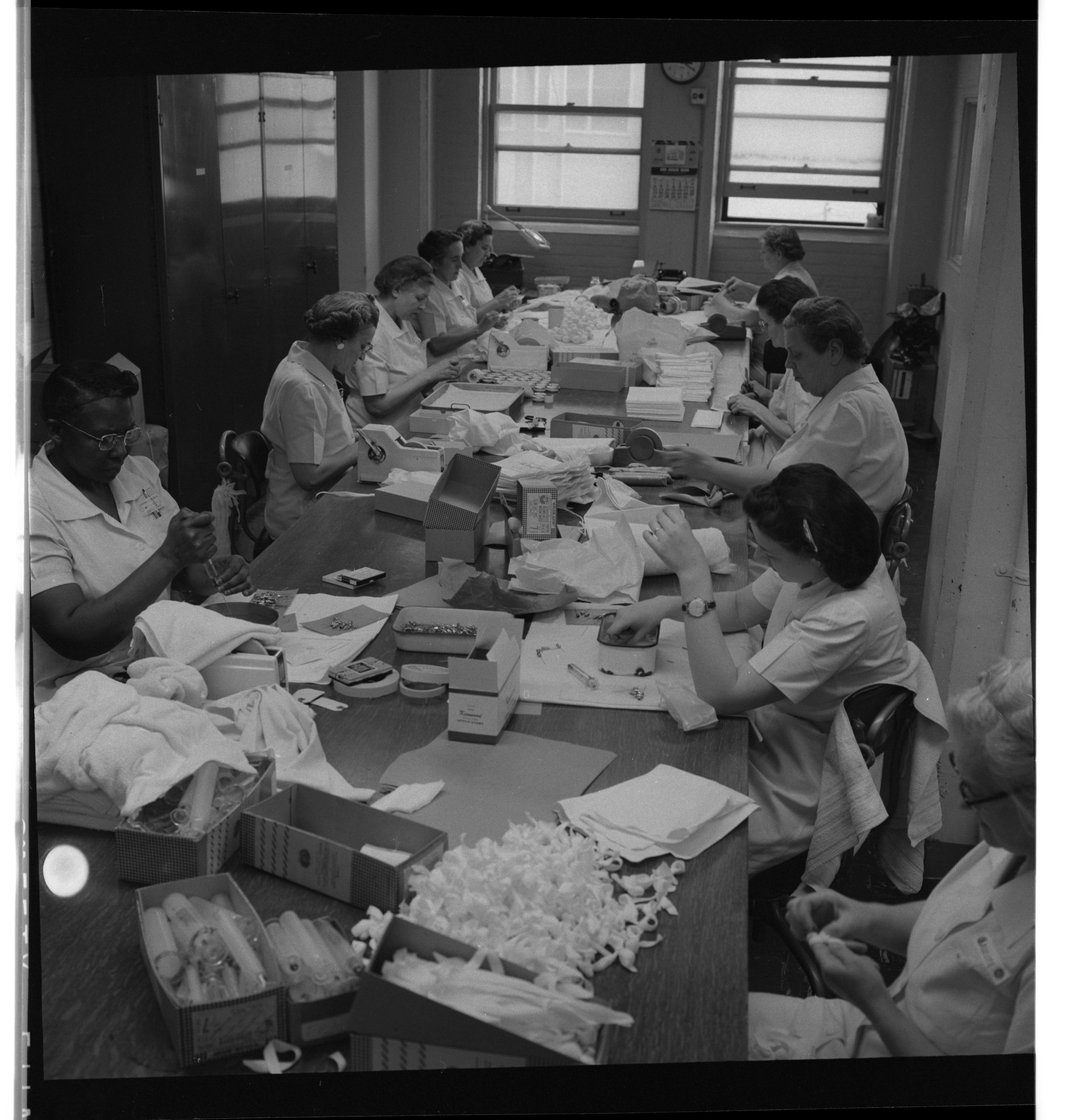 Women Preparing Medical Equipment At University Hospital