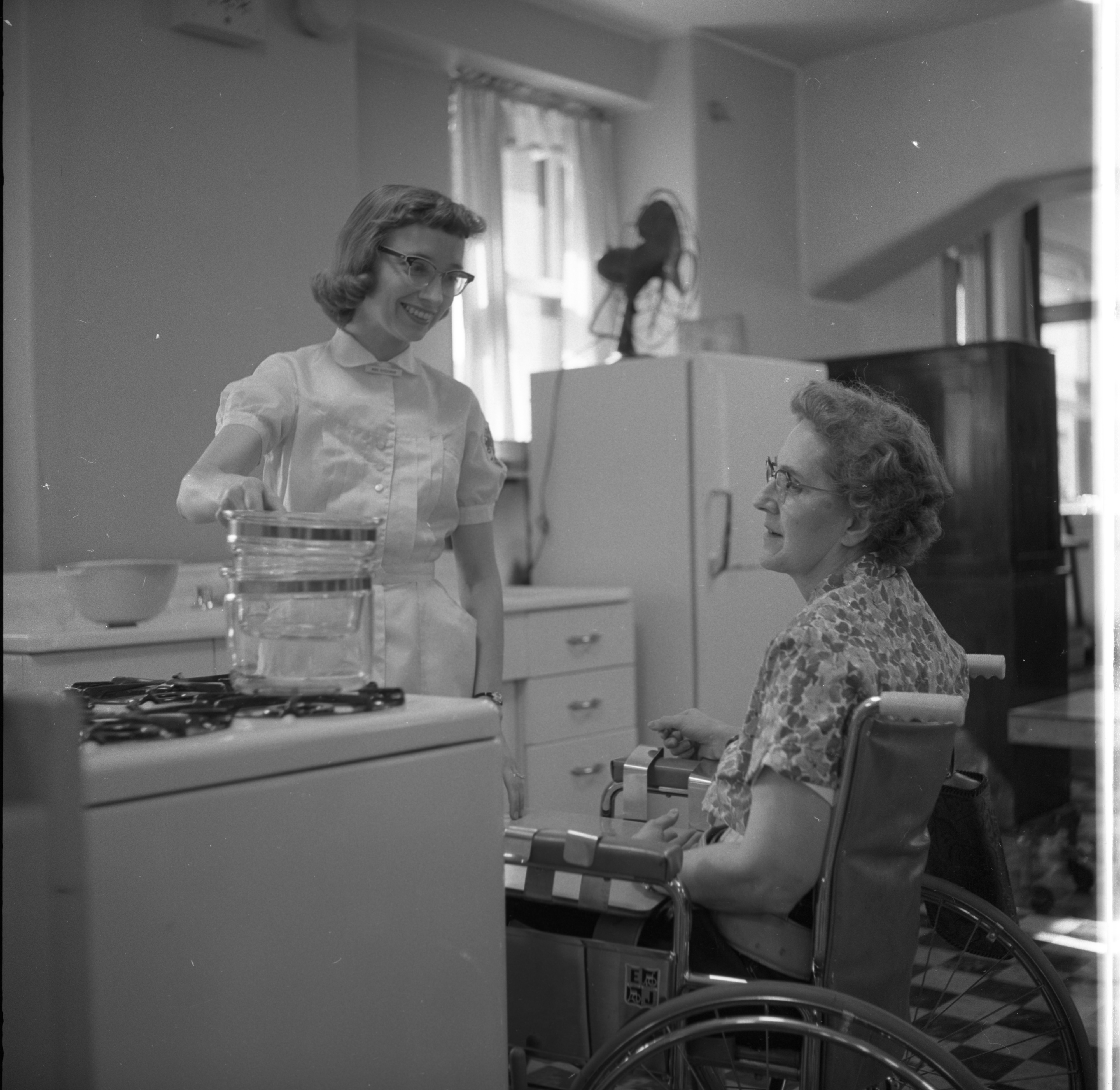 Handicapped Homemaker Olive Stone Learns Adaptive Cooking Skills at University Hospital, September 1958 image