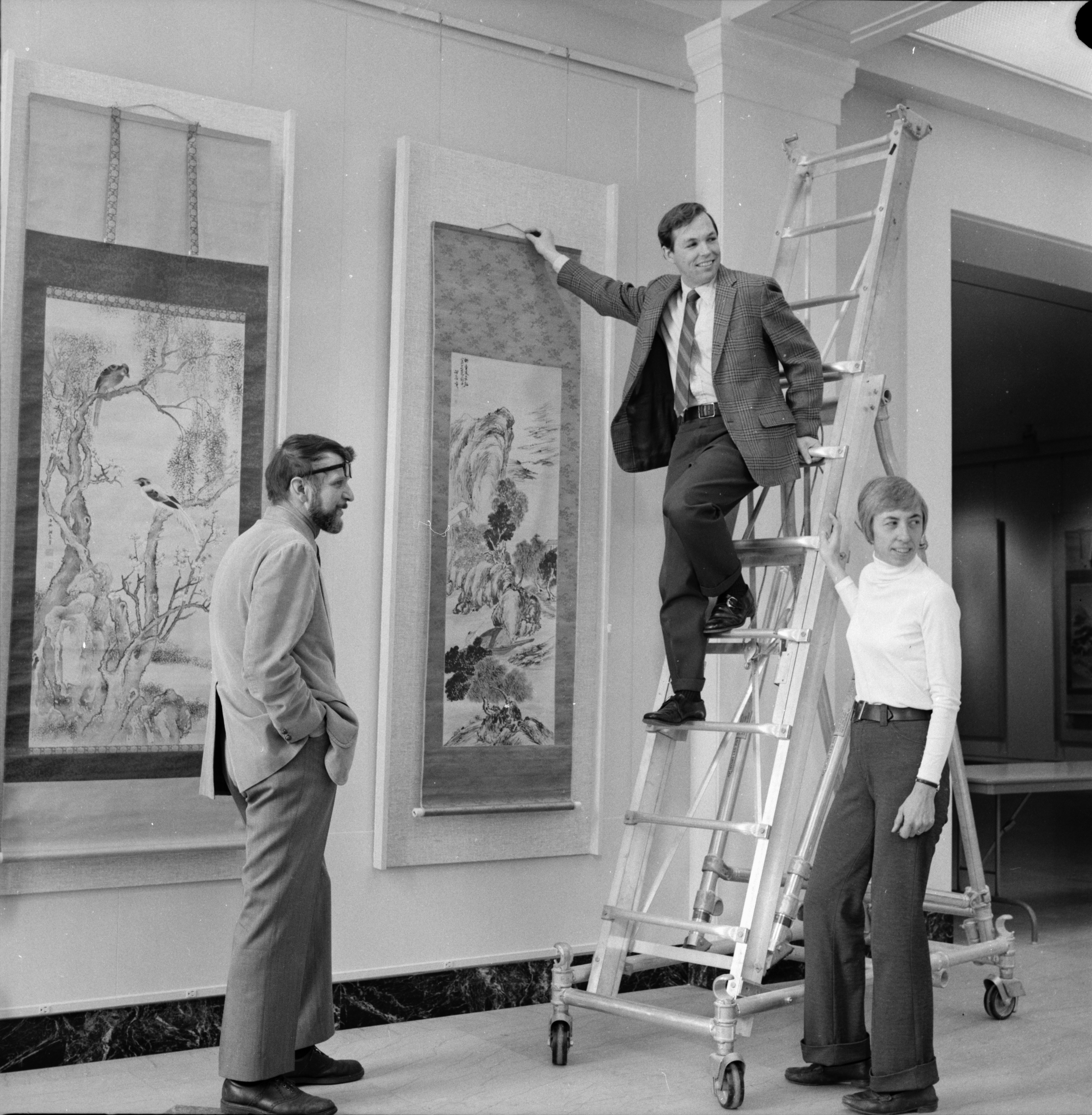 A. Bret Waller, John Holmes, and Nesta Spink Hanging Japanese Scrolls at University of Michigan Museum of Art, January 1974 image