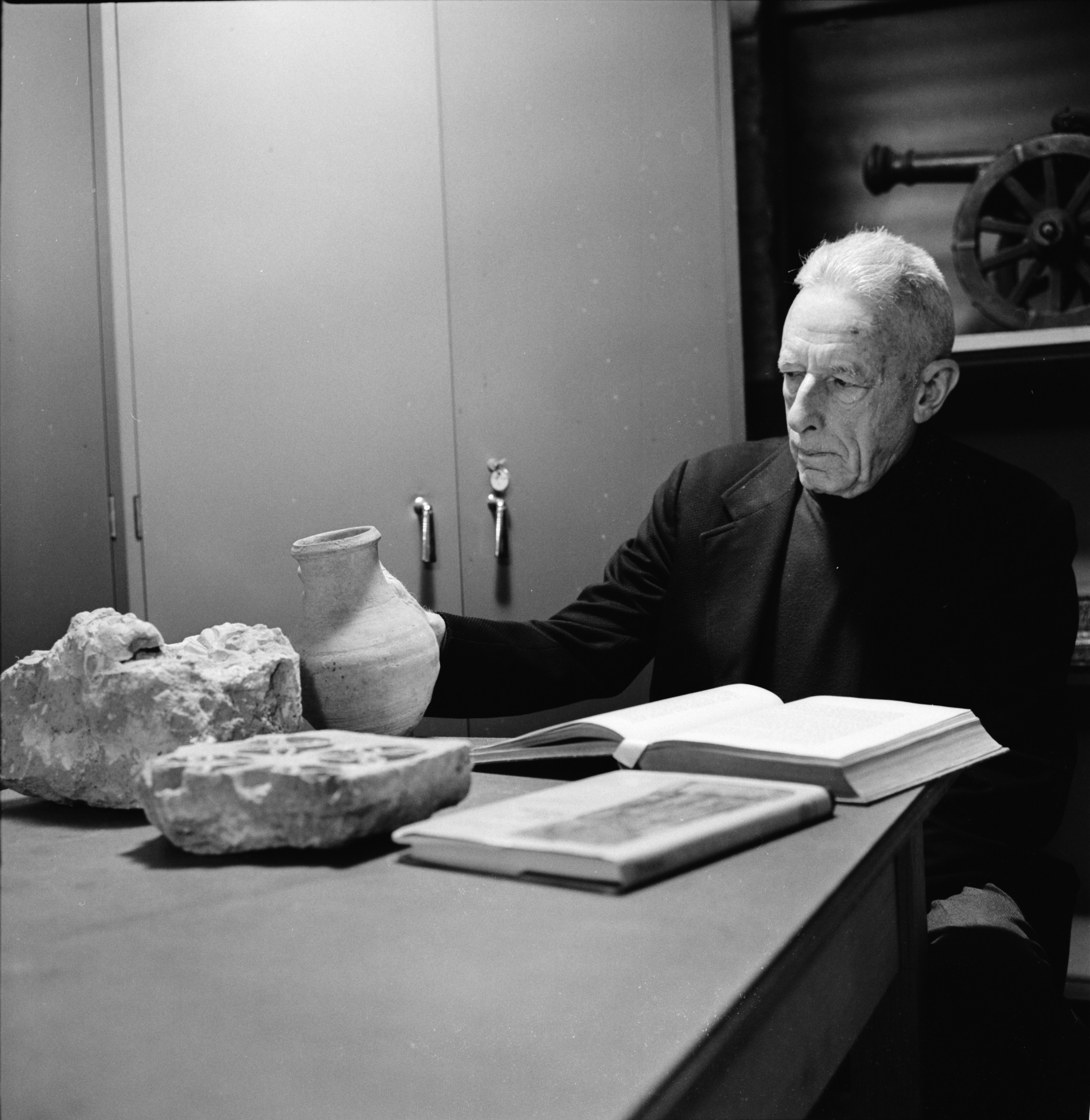 Professor Emeritus Dr. Clark Hopkins Studies Artifacts At Kelsey Museum, February 1974 image