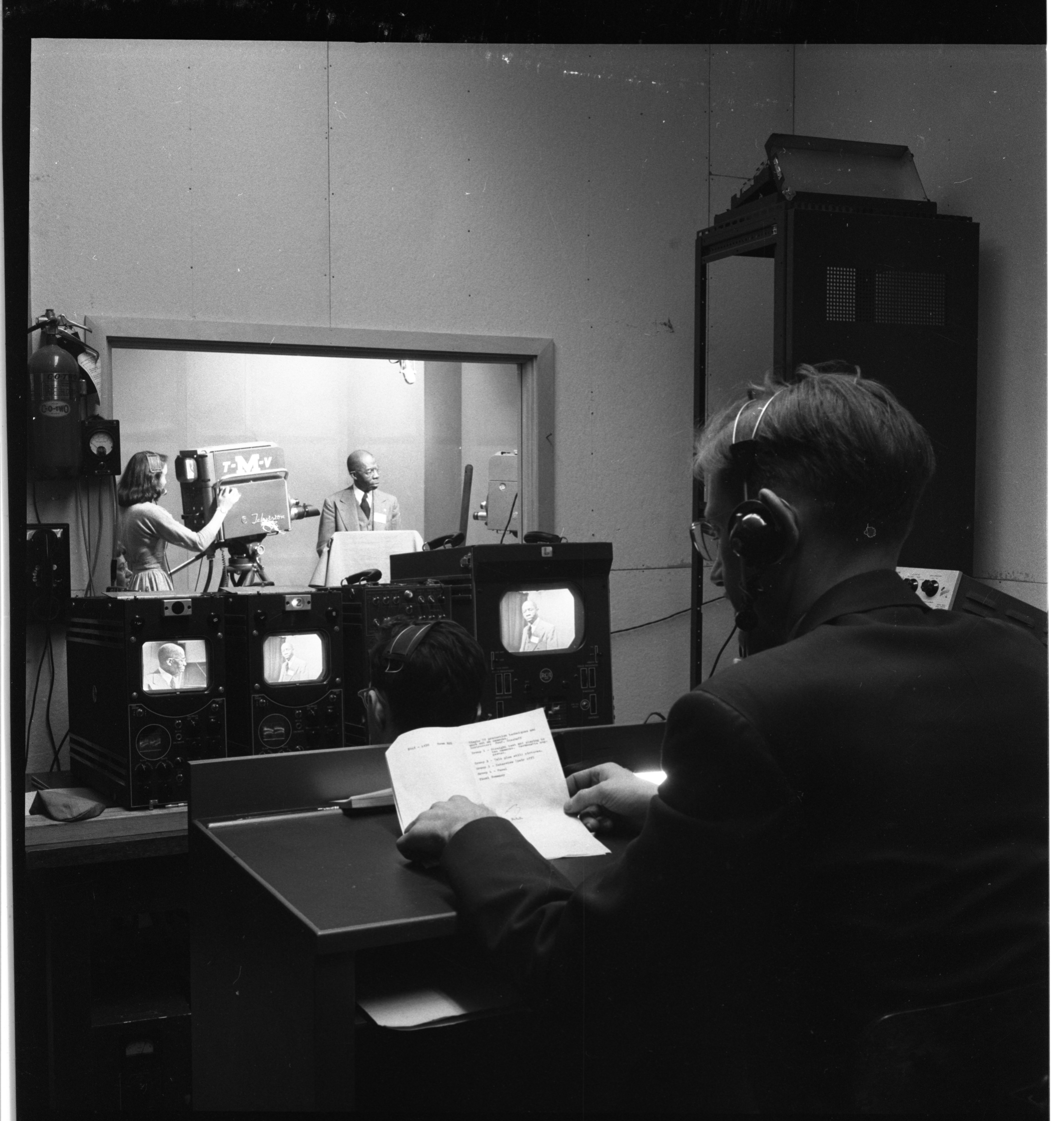 Technical Director Fred Remley watches Rev. C.W. Carpenter, U-M workshop on religious radio and TV, January 1953 image