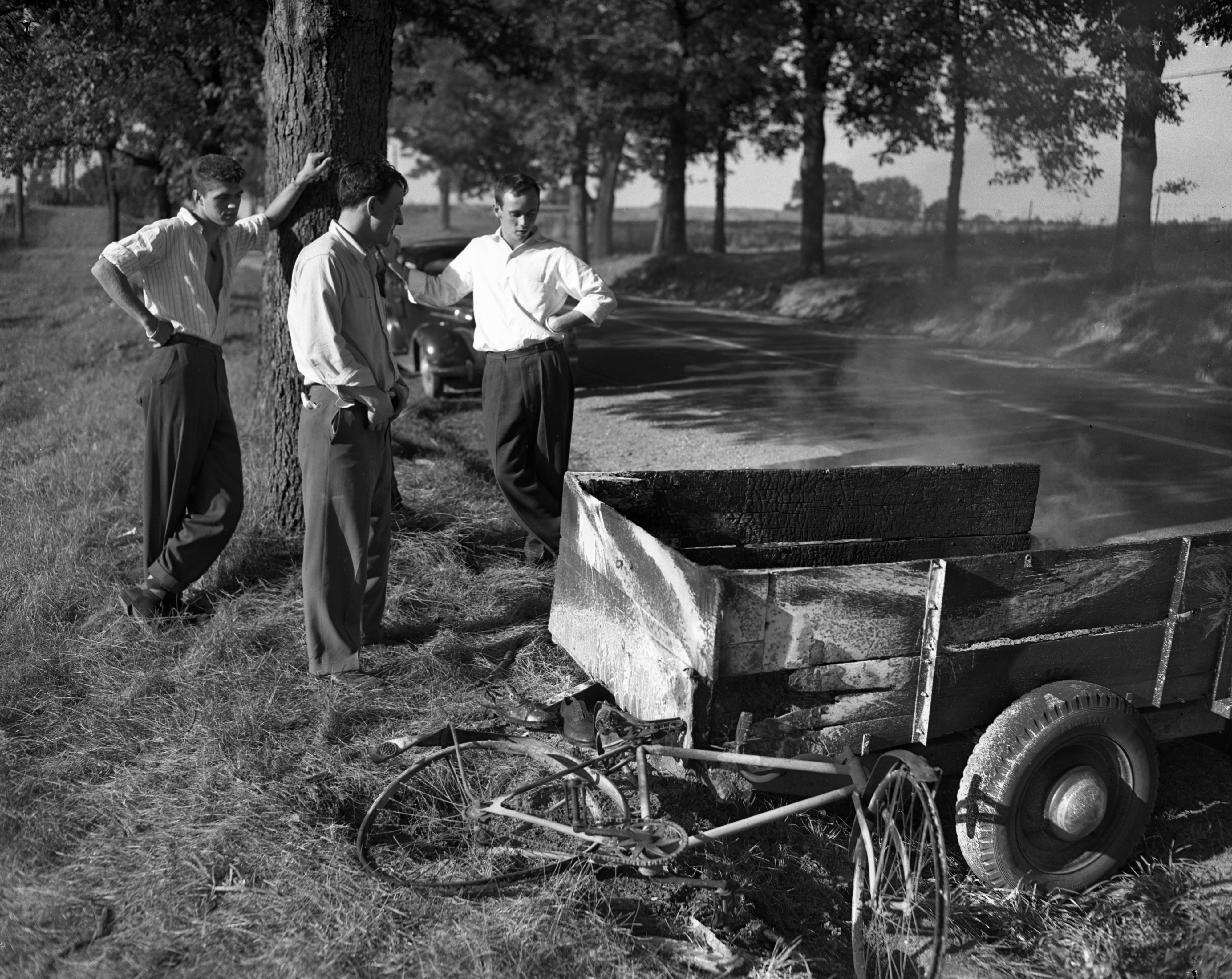 U-M students look at the remains of their burned-out trailer, September 1947 image