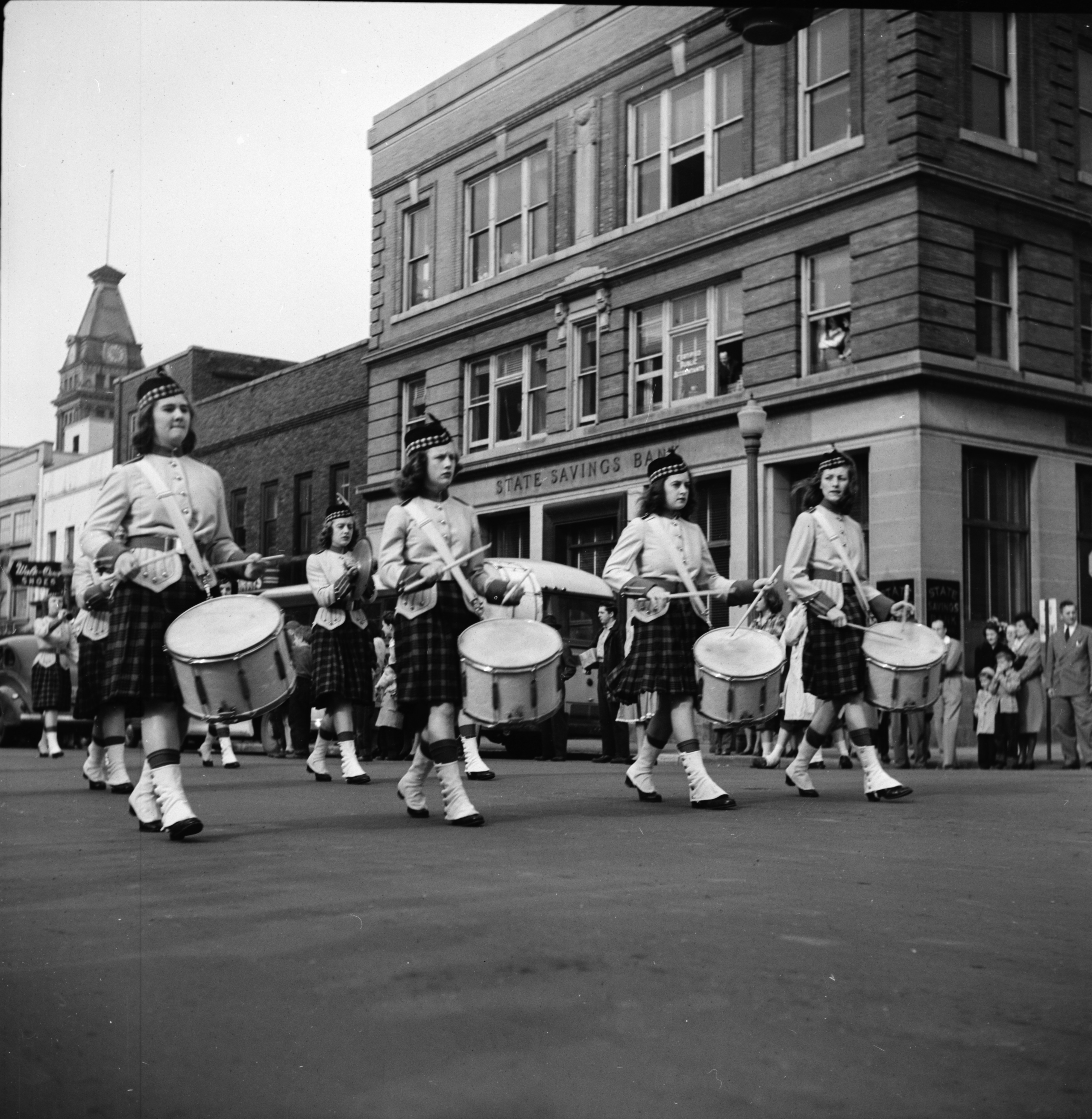 Female Drummers March by the State Savings Bank, U-M Michigras Parade, April 1948 image