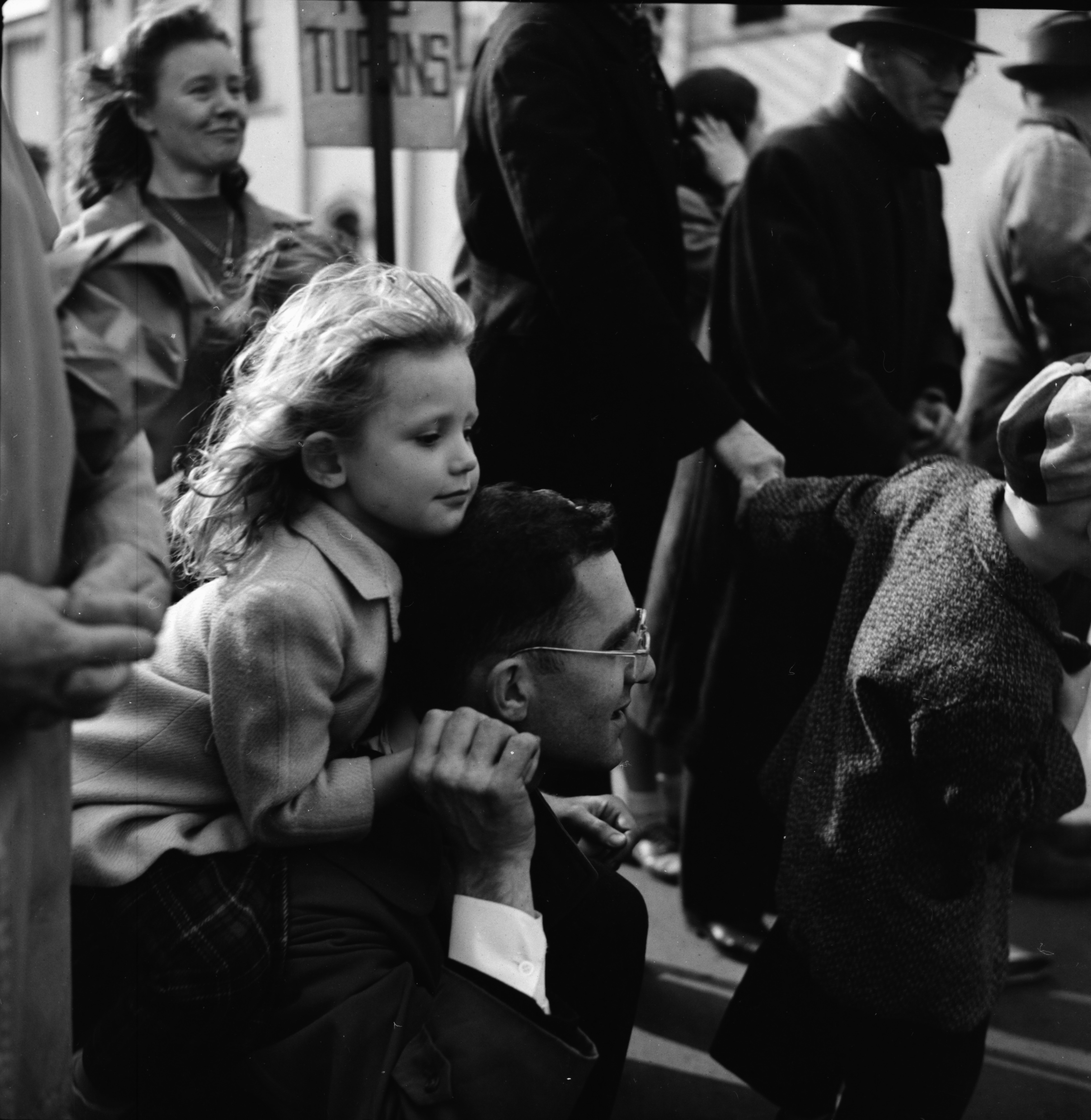 A Little Girl Watches the U-M Michigras Parade, April 1948 image