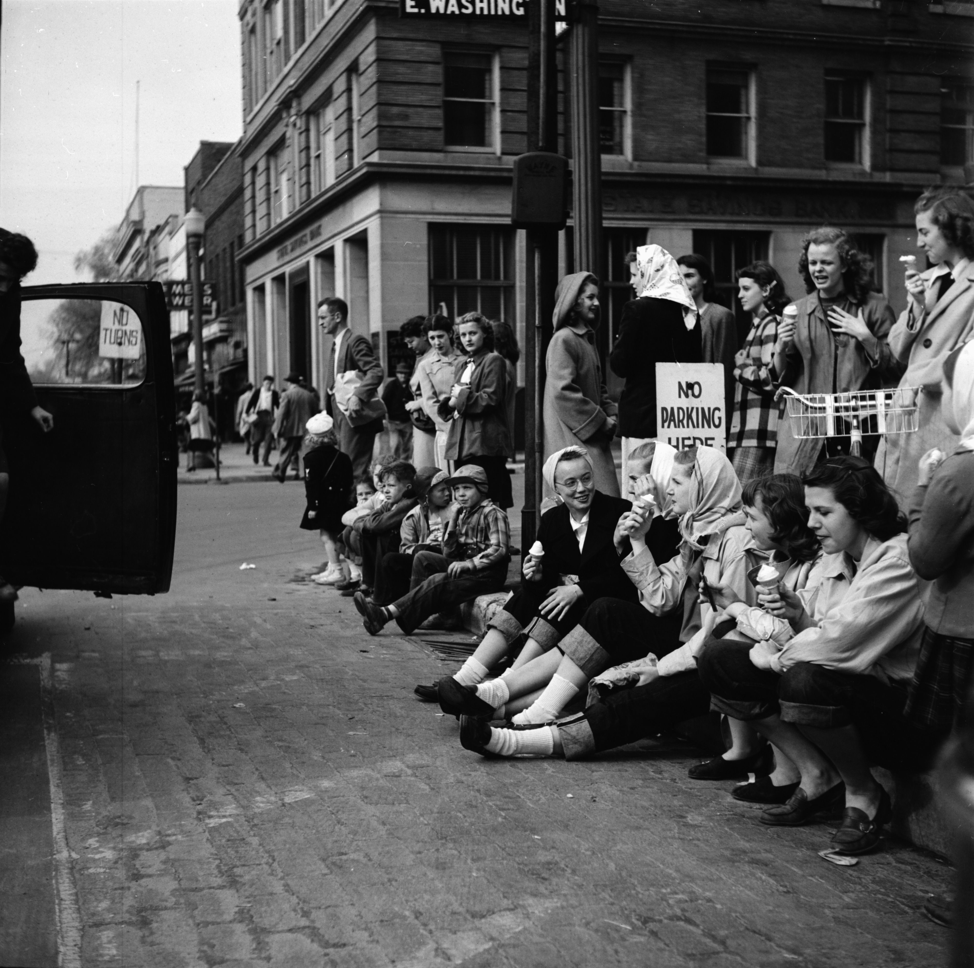 Eating Ice Cream and Watching the U-M Michigras Parade on the corner of Washington and Main Streets, April 1948 image