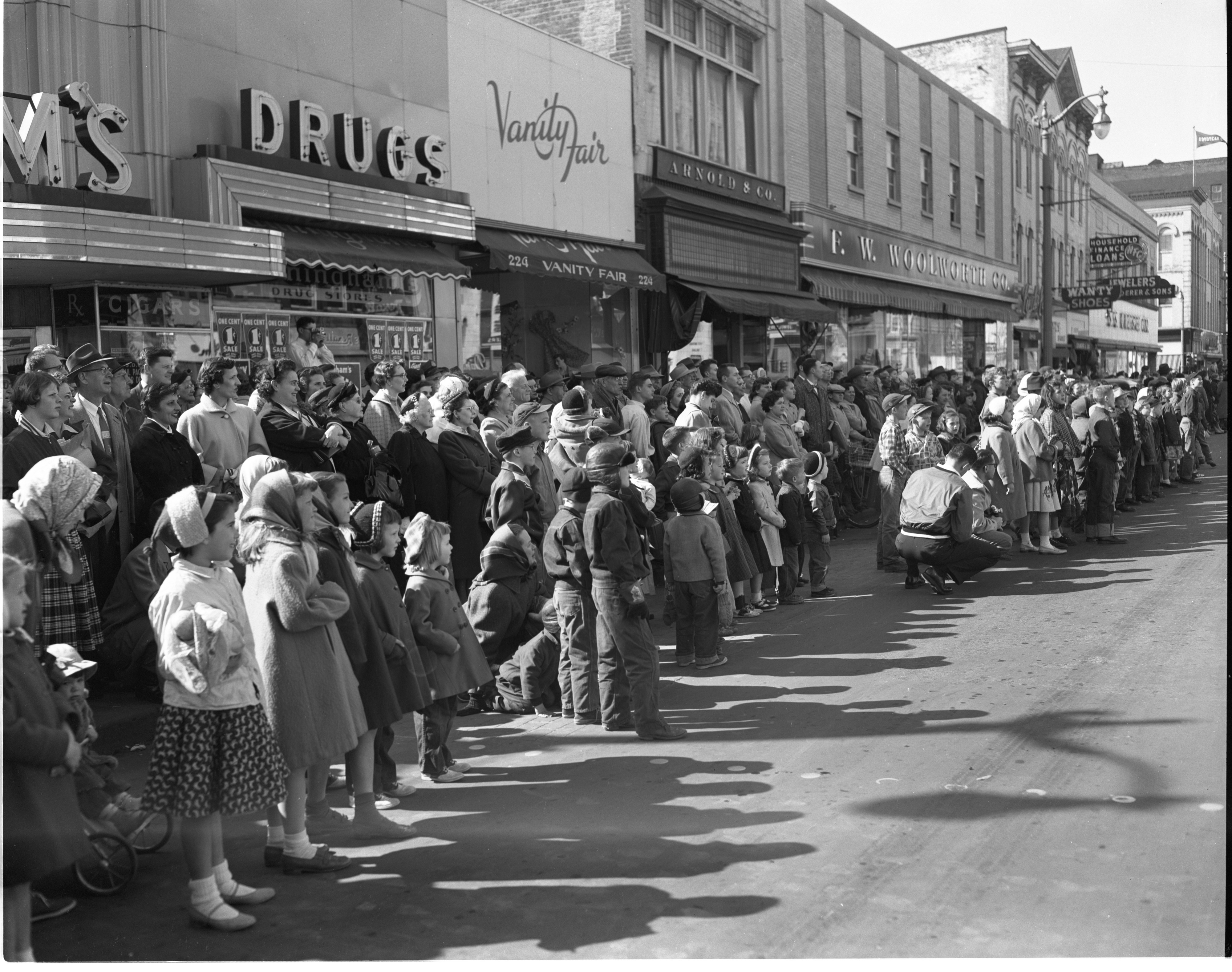 Crowds Line Main Street For The Michigras Parade, April 1956 image