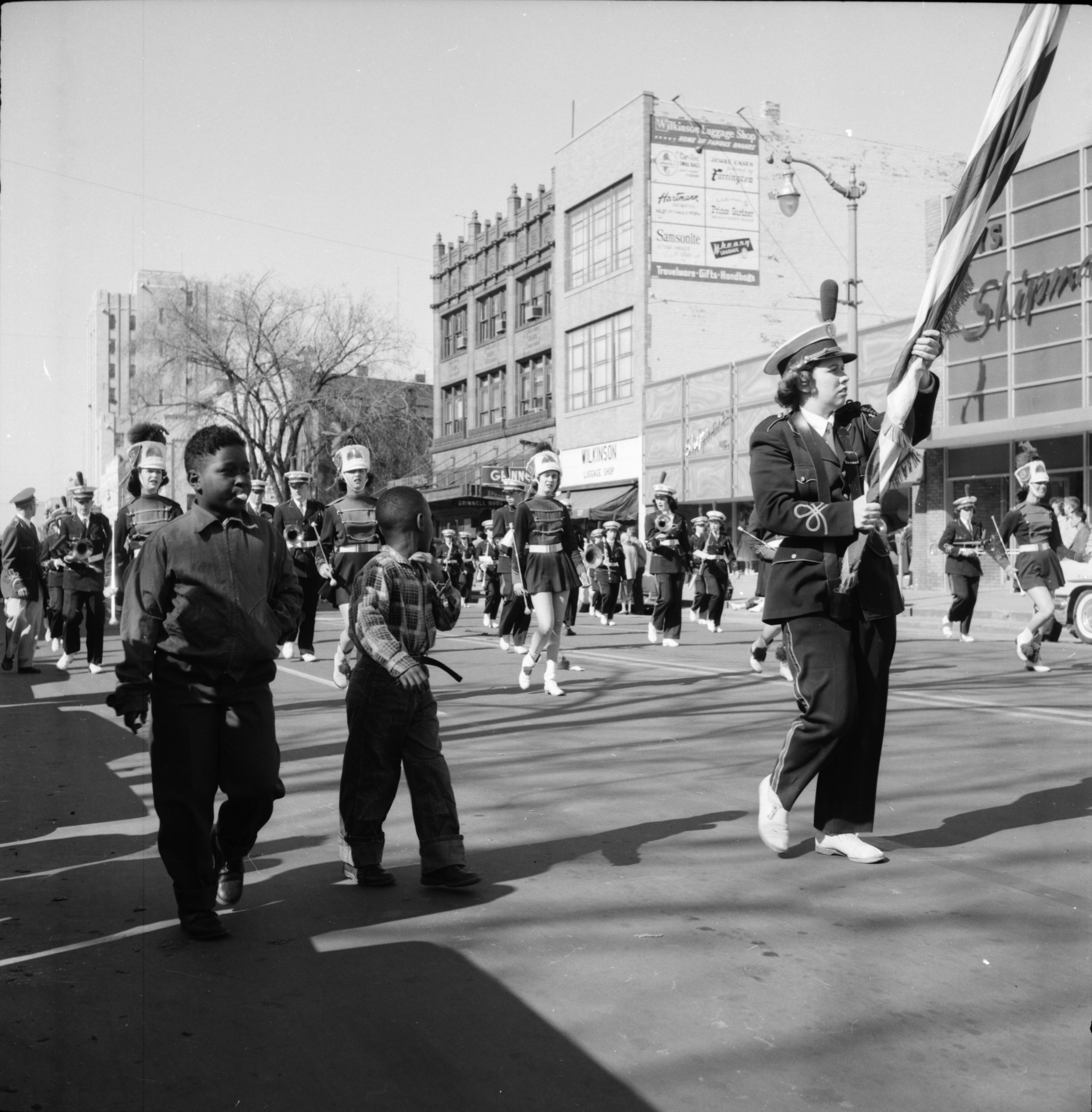 Marching with the Marching Band in the Michigras Parade, April 1958 image