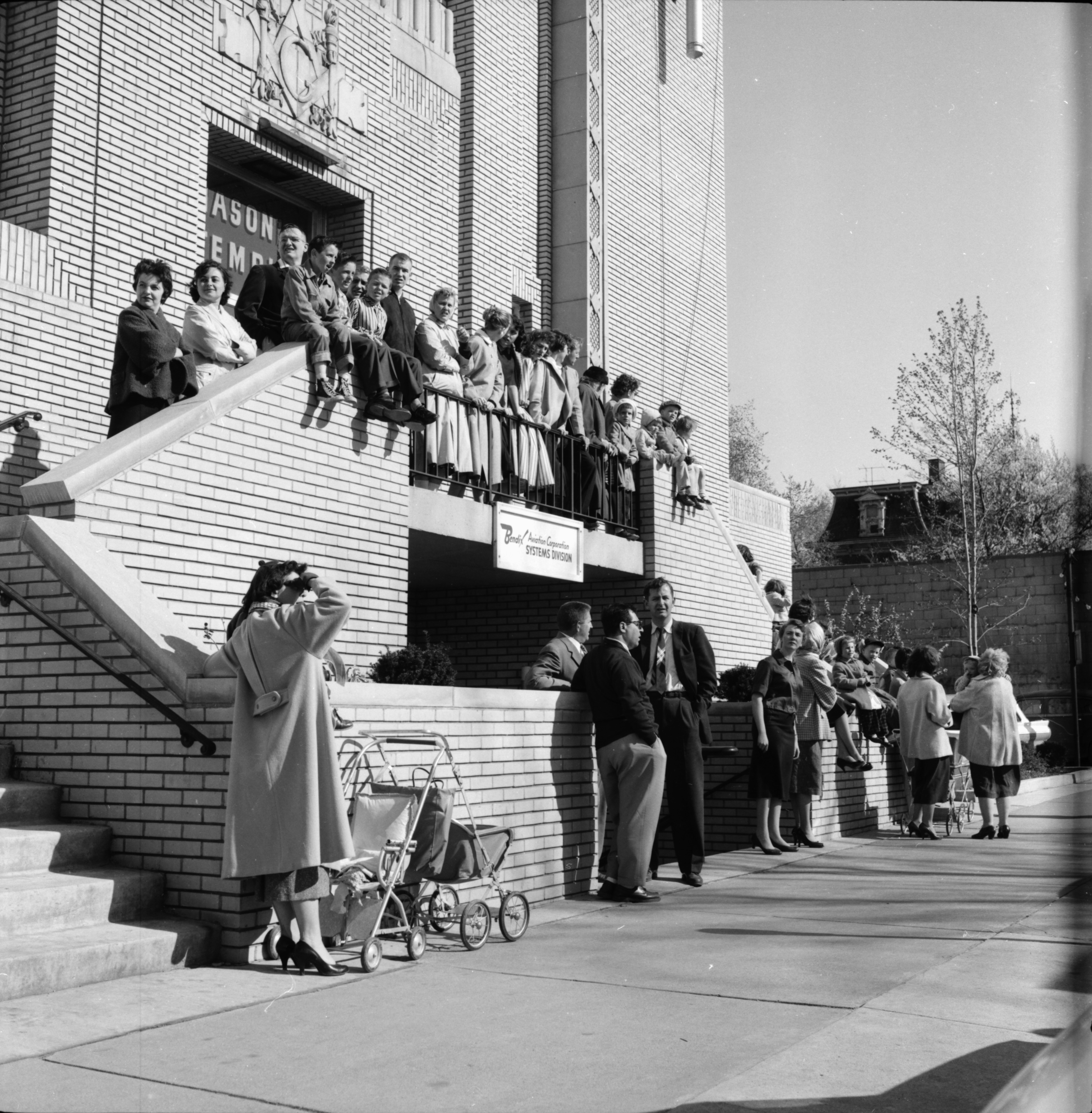 Spectators Watch The Michigras Parade at the Masonic Temple, April 1958 image