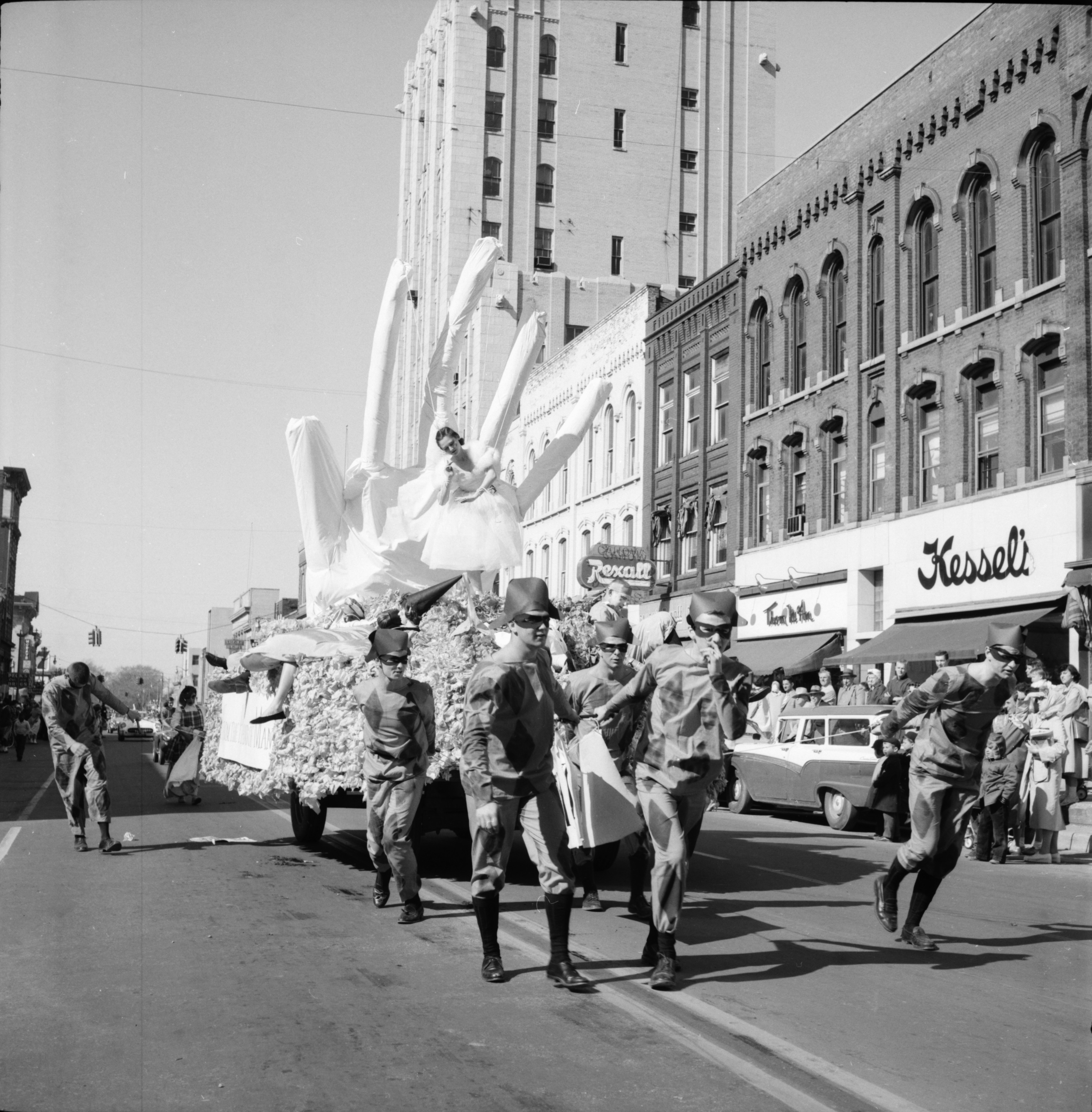 Sigma Nu and Kappa Kappa Gamma float in the Michigras Parade, April 1958 image