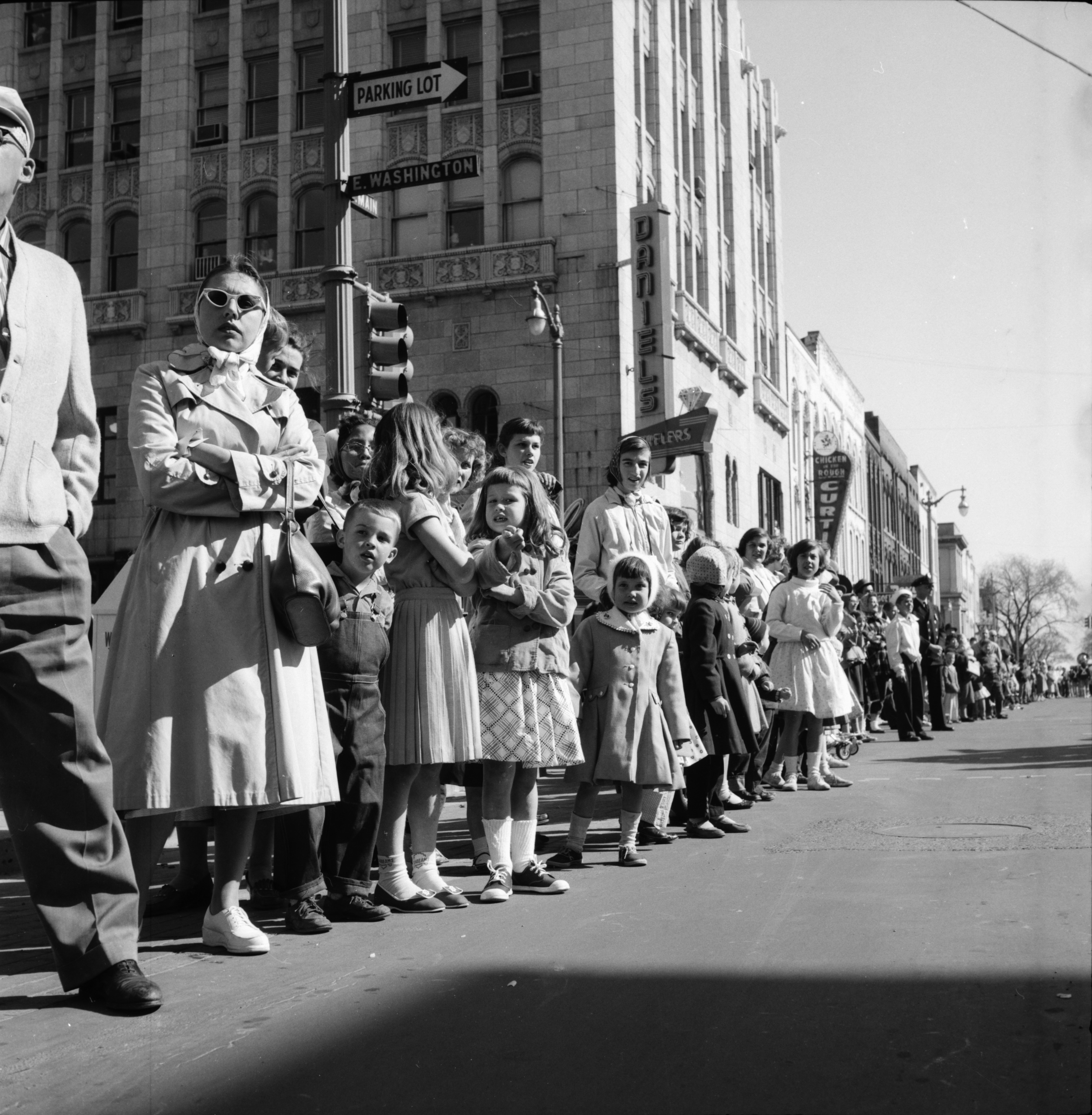 Watching the Michigras Parade at Main and Washington Streets, April 1958 image