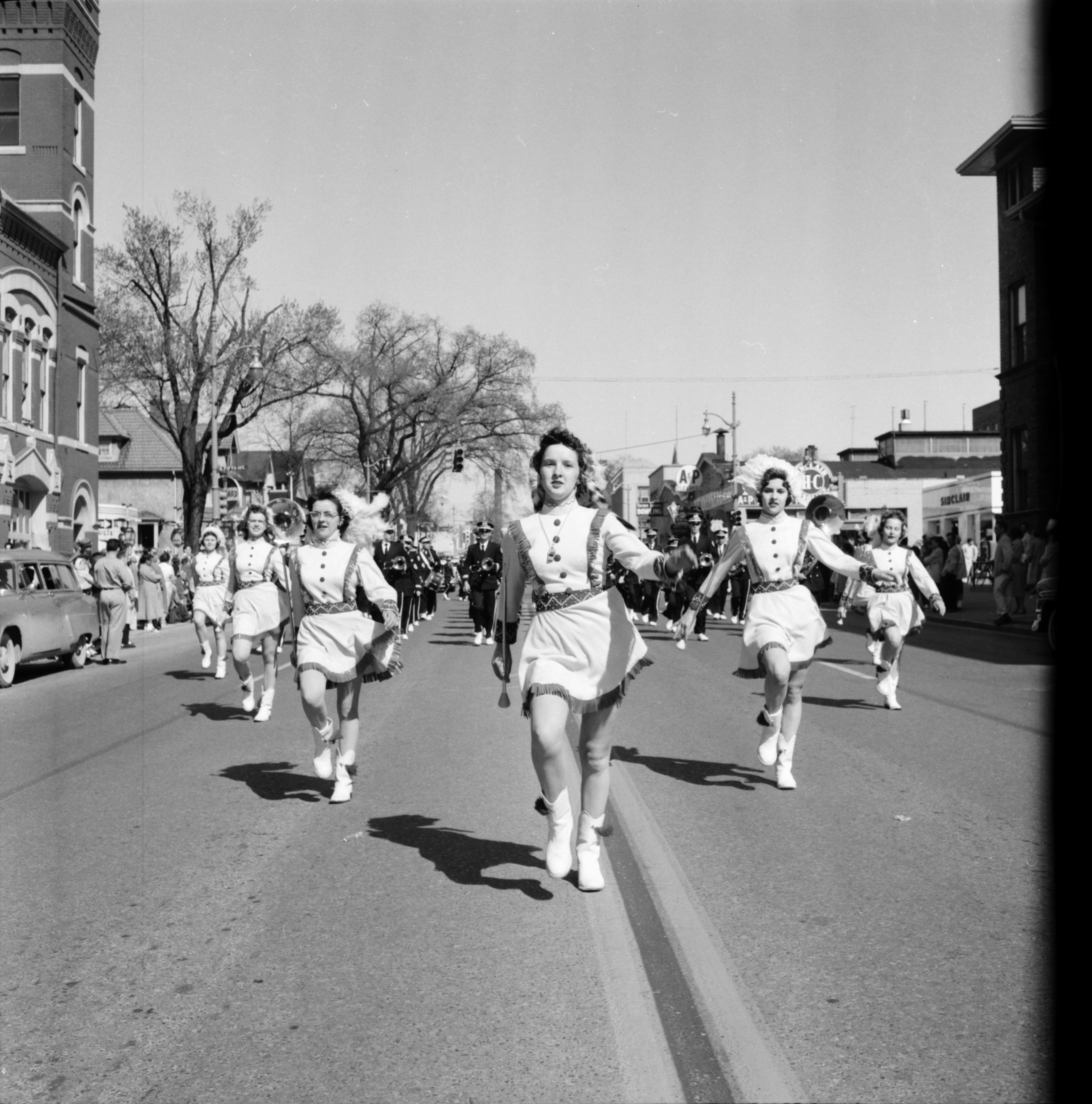Marching Down Huron Street in the Michigras Parade, April 1958 image